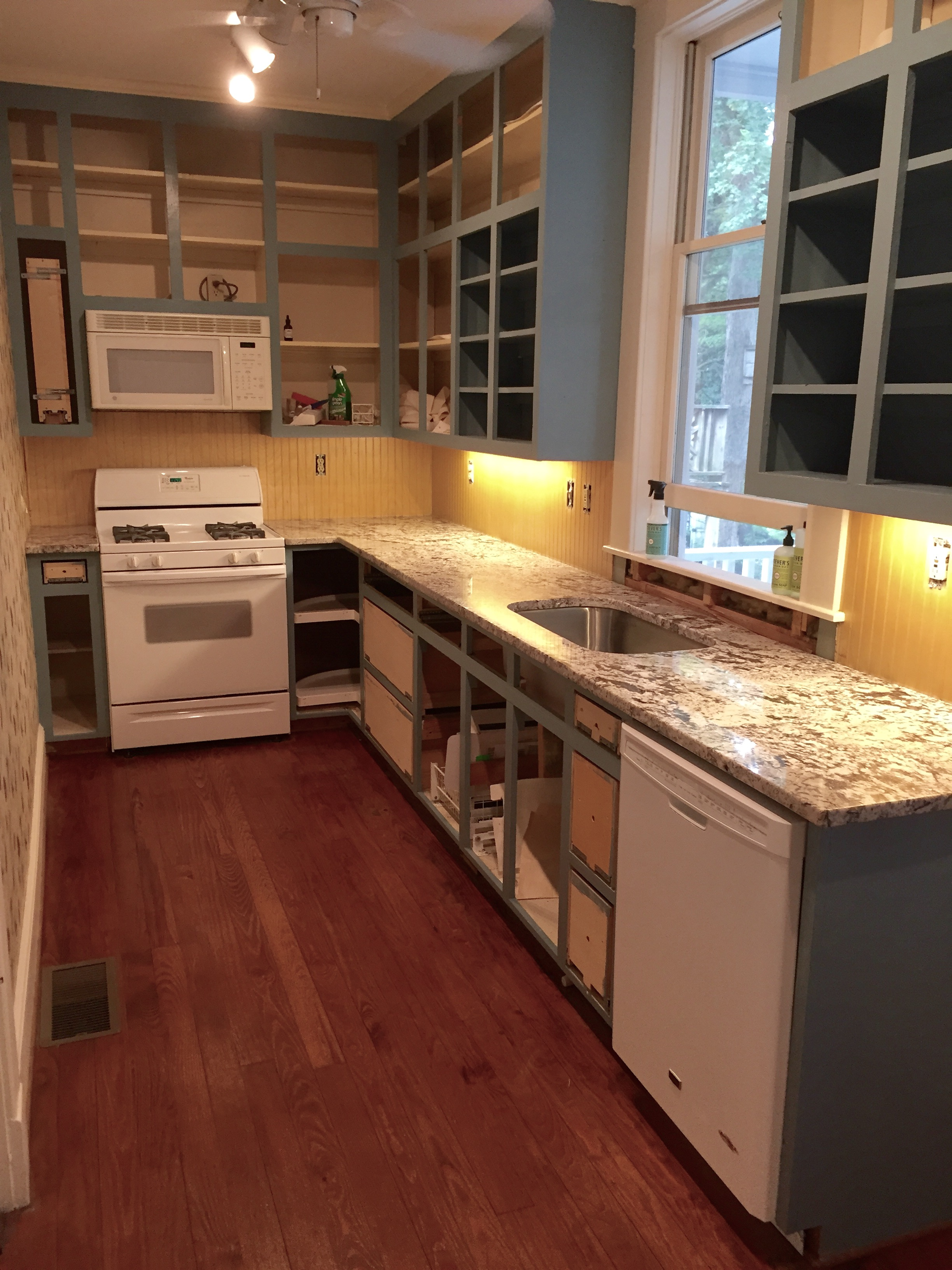 After the cabinet frames were painted, the granite was installed