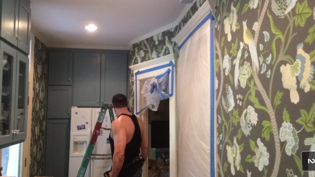 The final step was replacing the vegetable wallpaper with Thibaut's Janta Bazaar in Charcoal.