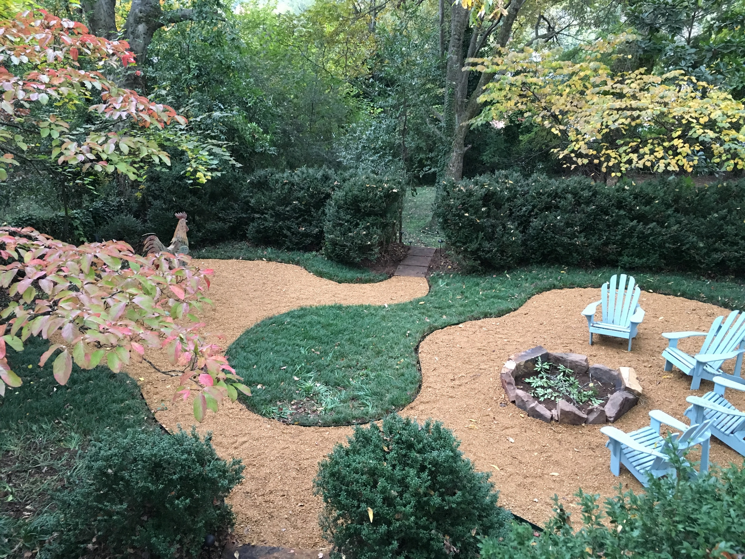 The hardscaping is complete, but we still need to plant flowers and clean up the hedges.