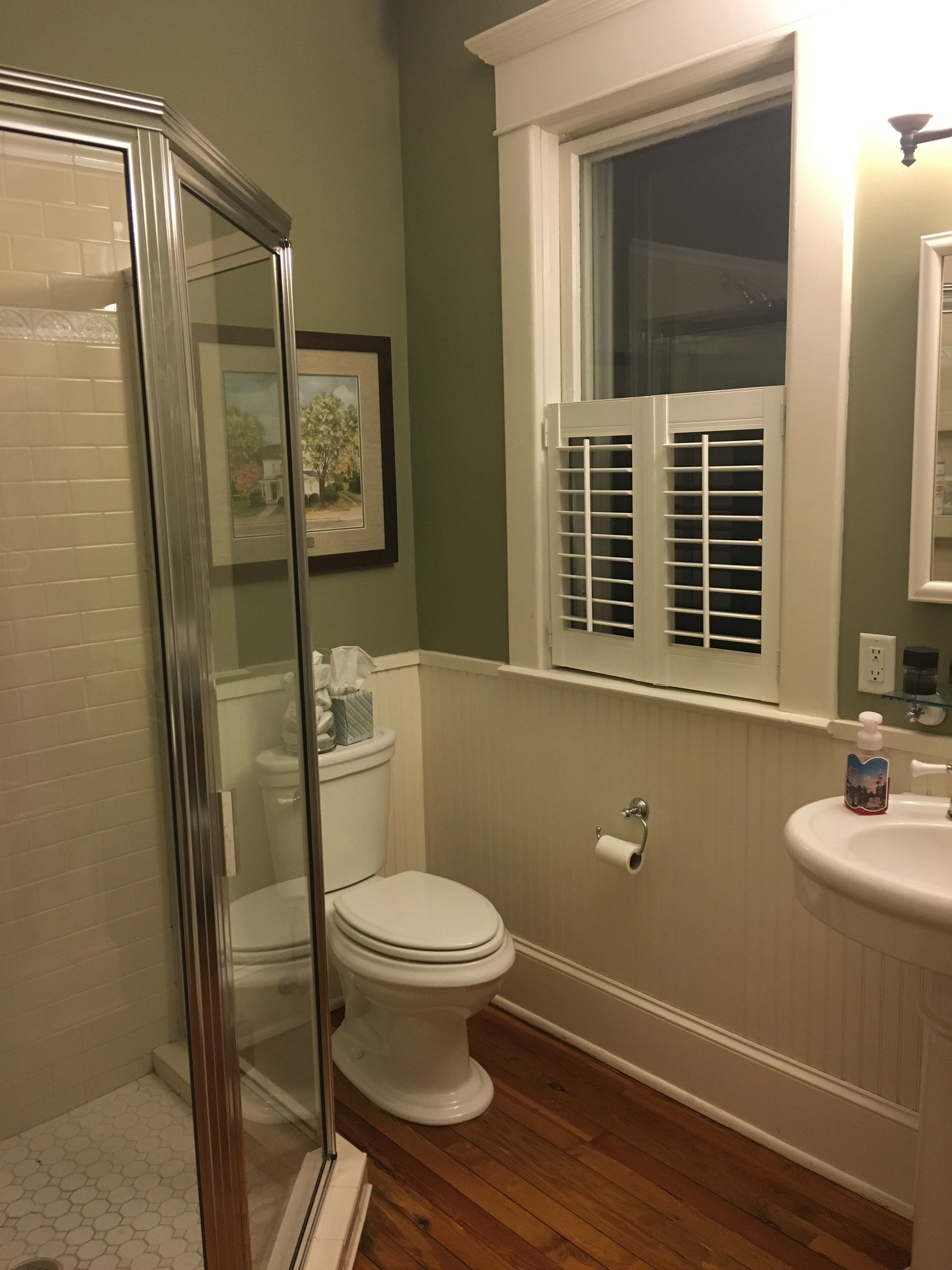 The bathroom before was attractive, but the wood floor wasn't practical and the shower leaked.