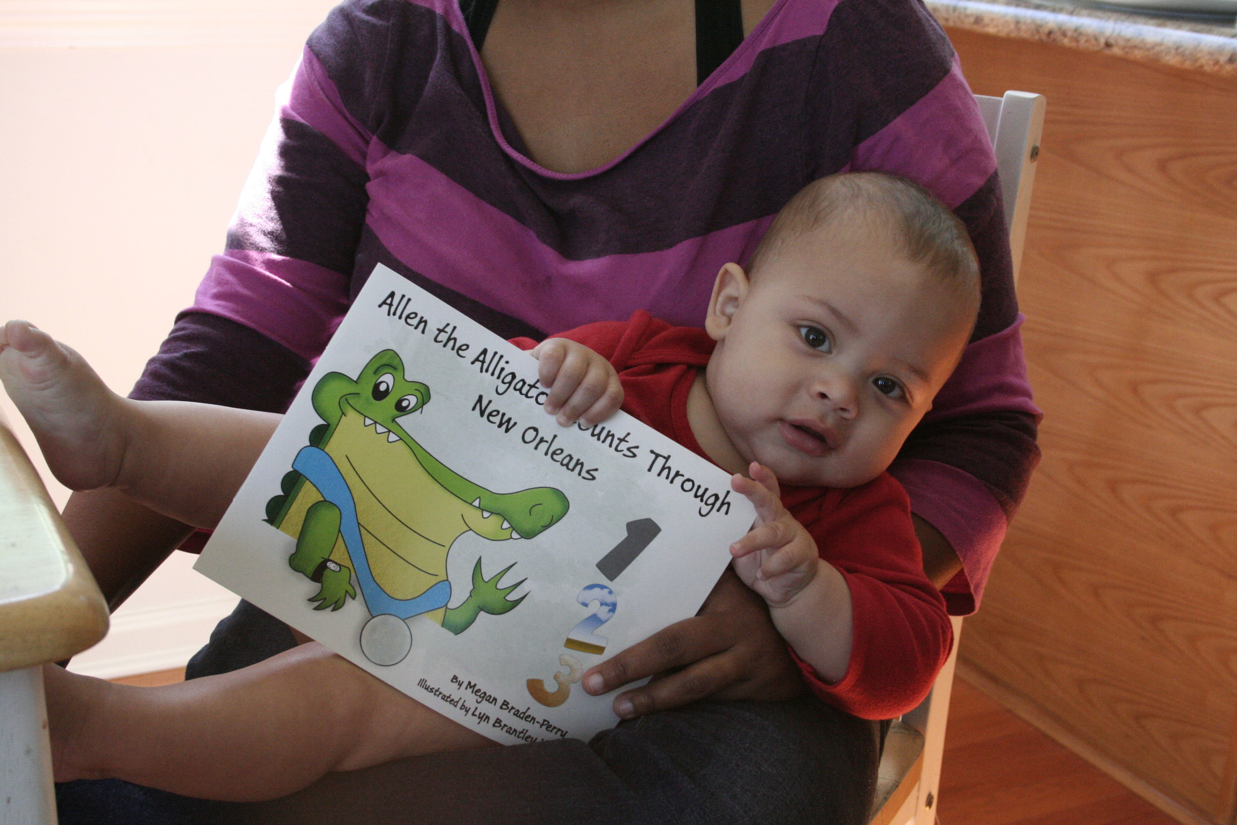 megan and her son showing off the advance copy of our book.