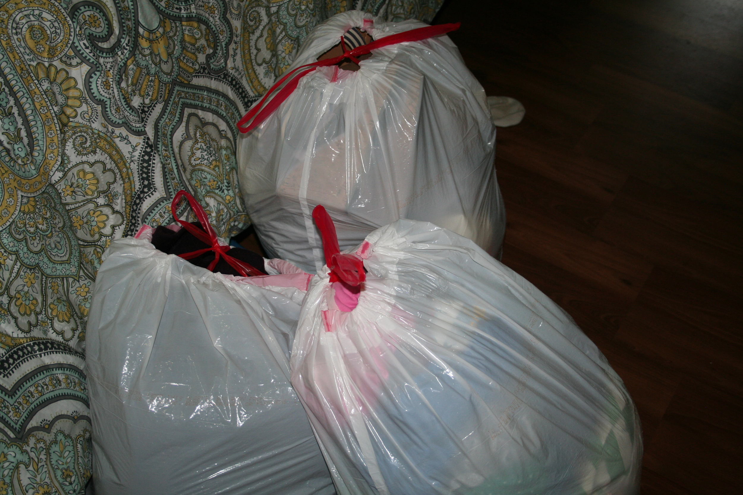 Here is the result of my purge, three garbage bags full of clothes and shoes that are going to a thrift store.