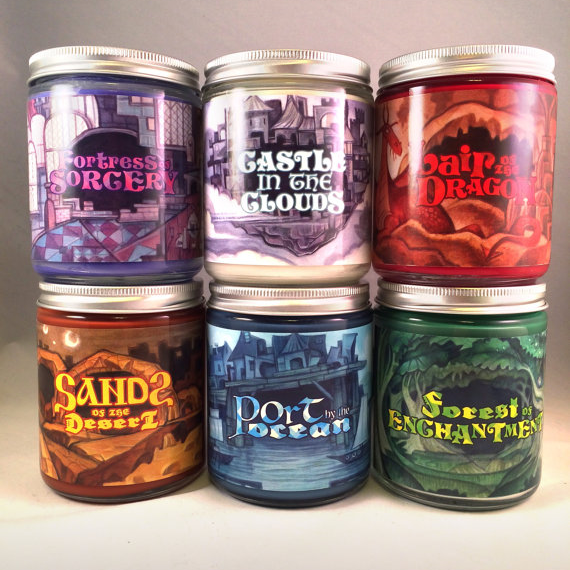 these candles have metal dice embedded in them! from boonzy arts candles on etsy