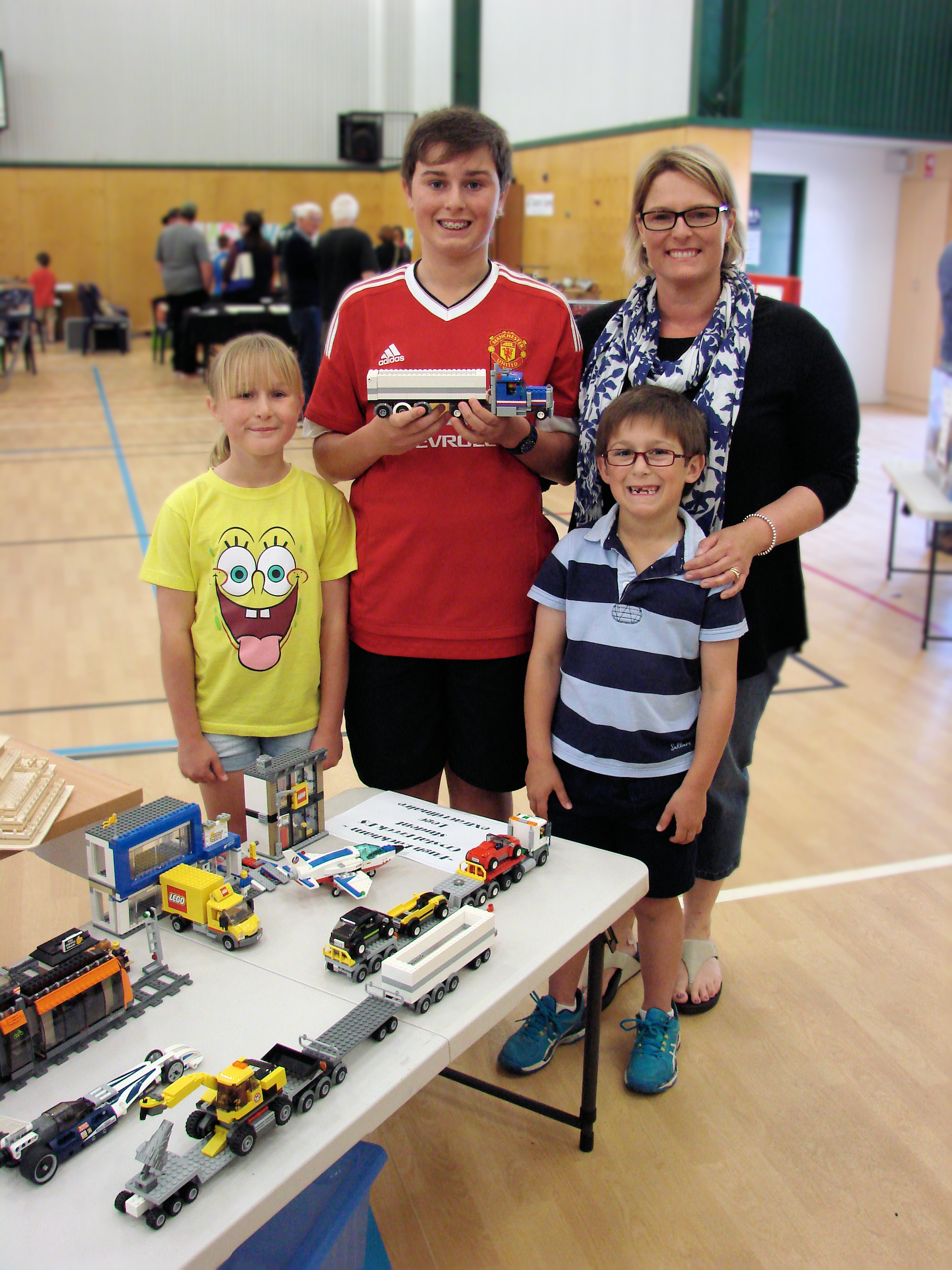 Left to right: Laura, Hugh, Julie and George Rackham with the Lego Models that Hugh made for the Model Railway and Hobby Show.