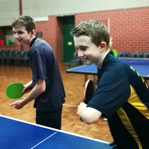 students playing lunchtime table tennis