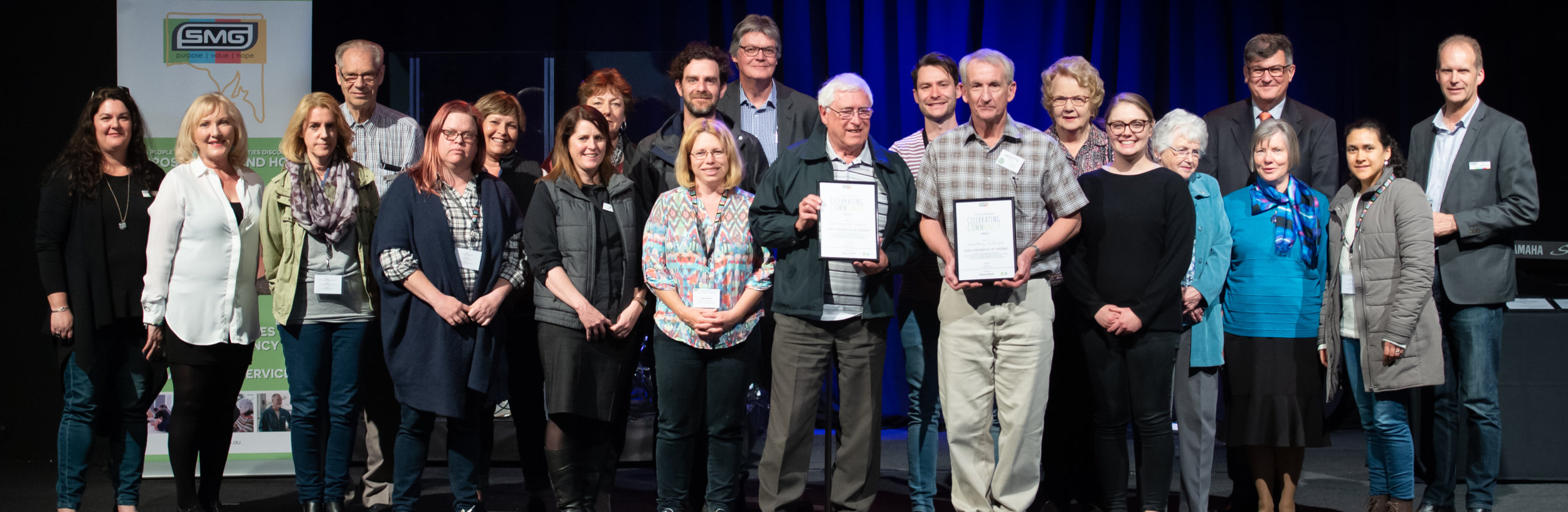 Angela Jolly, SMG Executive Director; Graham Brown, Chairperson; Lynn Arnold AO SMG Patron; Peter Skurray, Chaplaincy Services Manager; and Margaret Green, Community Development Manager Beyond Bank with awards winners