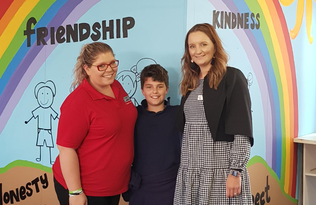 left to right: Lisa Babanin, Nicholas, Student and Colette Bos, Principal