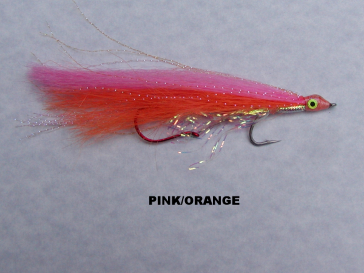 "PINK/ORANGE:  This is the HOTTEST UV fly in my selection.   It has ""COHO written all over it"".  If you believe in ""Bright day, bright fly"" this is your go-to sunny day trolling fly.  Rumor has it that the majority of silvers caught with this fly have been wearing wrap around shades."