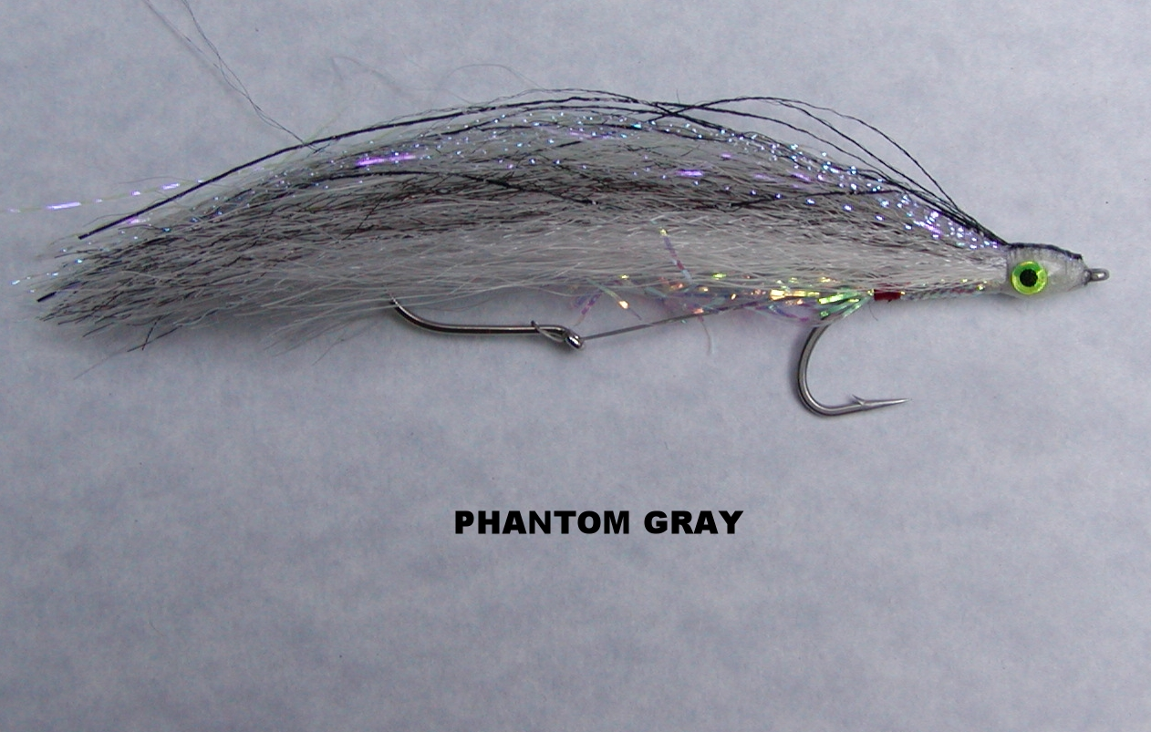 My Phantom Gray features UV Herring Back Krystal Flash and a pearl mylar belly to reflect a bit of light.  The inspiration for this fly is the exact imitation school of thought when tying a streamer fly.  In nature bait fish are camouflaged in their surroundings.  The bait fish is there but not obvious.  Fading into the background is what predators expect to see.  Gray is another traditional color for Vancouver Island trolling flies.