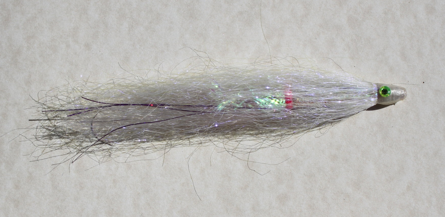 Purple Haze is pearl with UV high lights as well as holographic purple flash in its core.  The UV and the holographic purple are visible deep in the water column.  This is the preferred color with my Northern California saltwater salmon customers.