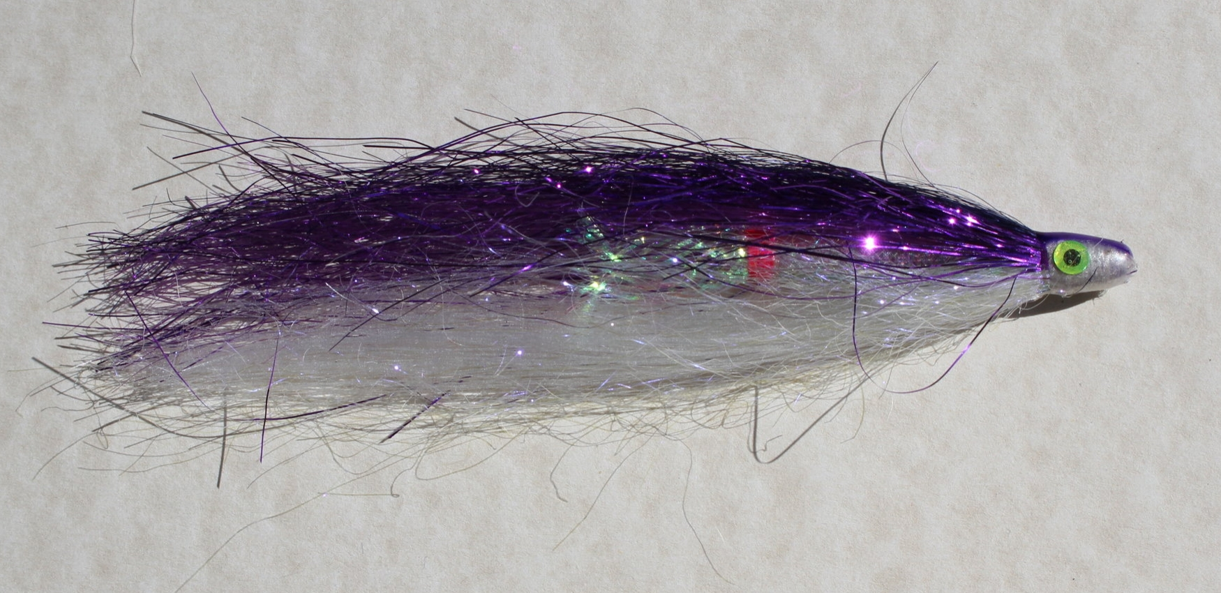 PURPLE/PEARL,  Purple is the last color  of light to be filtered out as you go deeper down the water column.  I have added this color by request from the Kachemak Bay anglers.  This works well on kings as well as silvers.