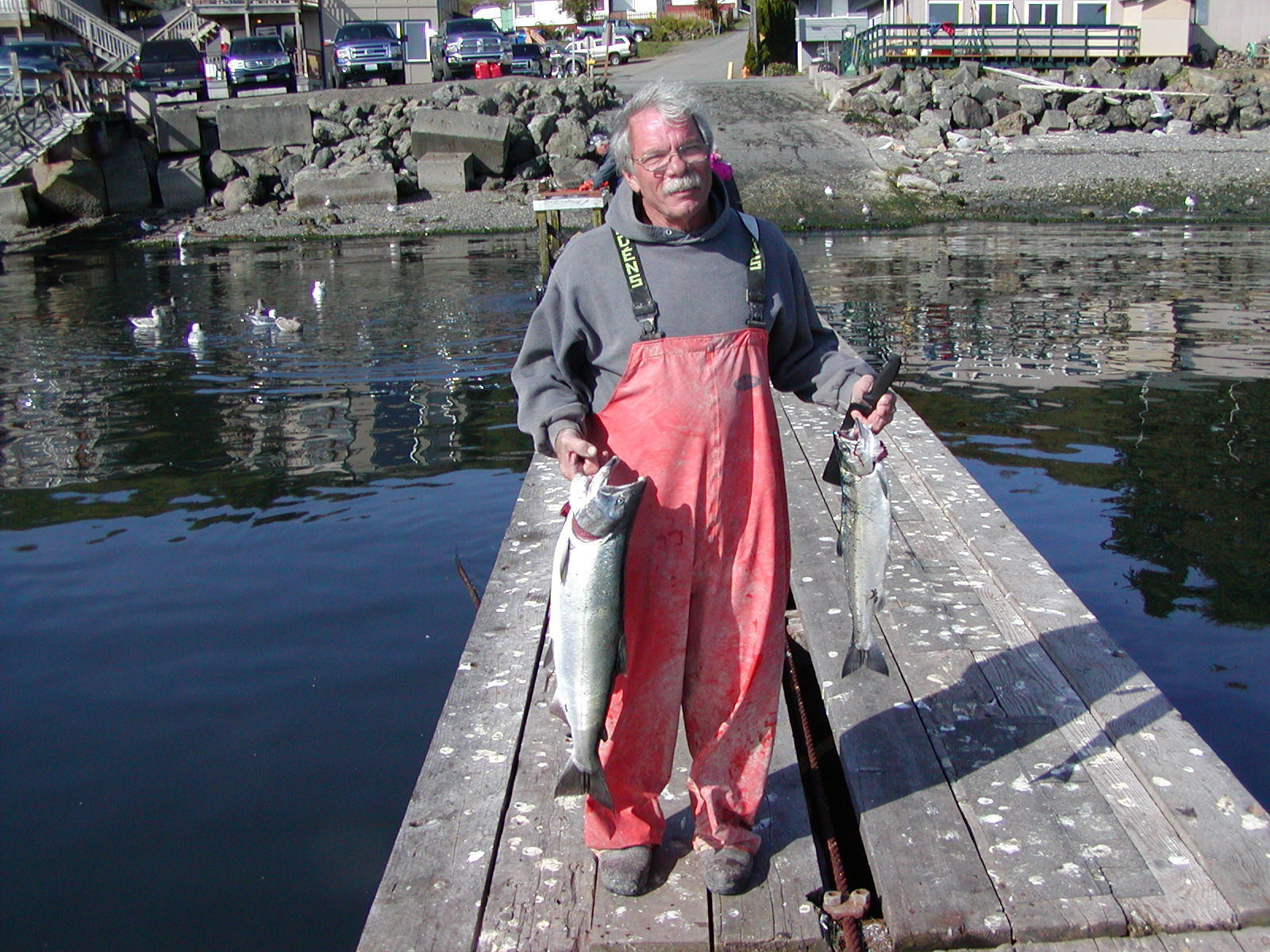 PJ two salmon on dock.JPG
