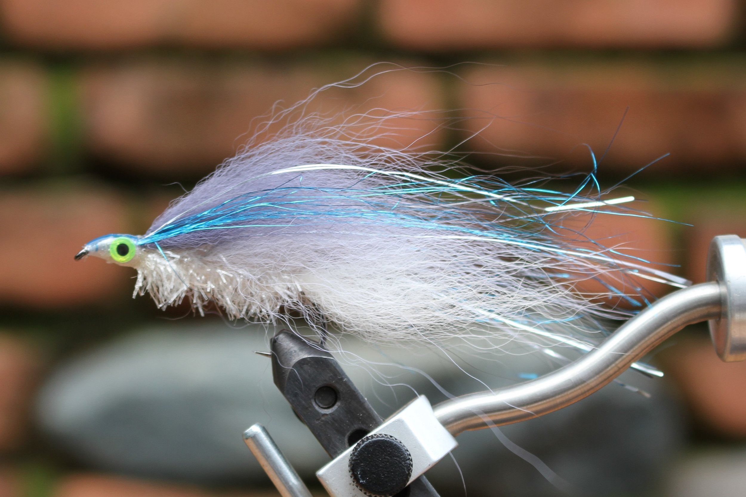 BLUE Shad, #2 Arctic Fox Trolling Fly. This is the most requested color by my Great Lakes customers. The blue-gray fur has royal blue mylar as an over lay. The flash on the side is silver. A classic combination.
