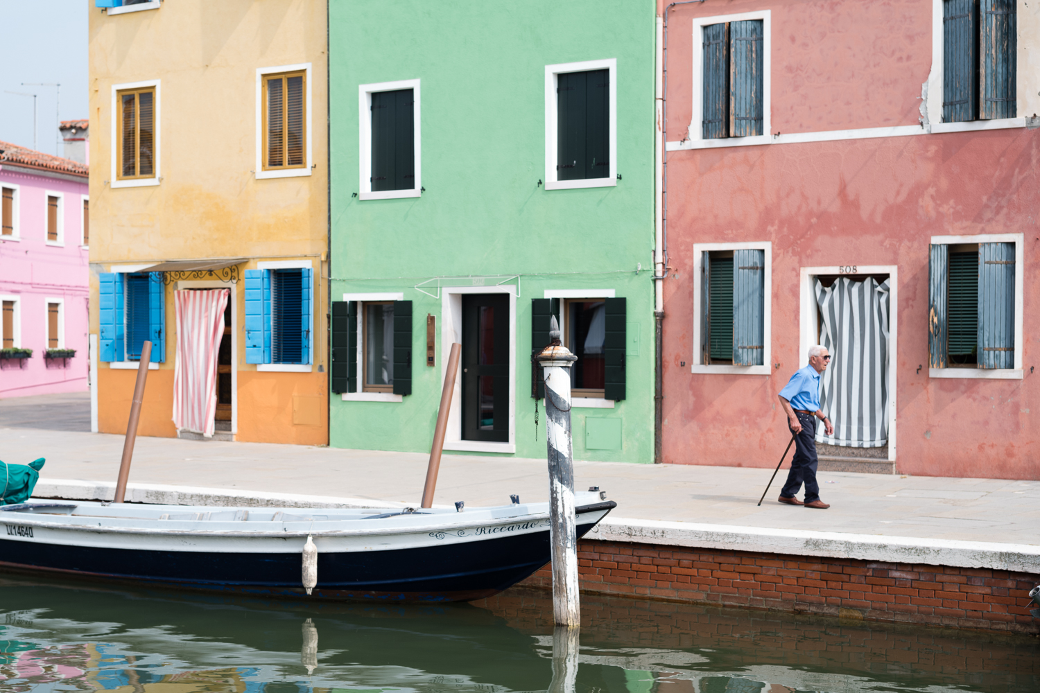 Burano color palette + wandering man     Leica M10 1/1000s F2 ISO100