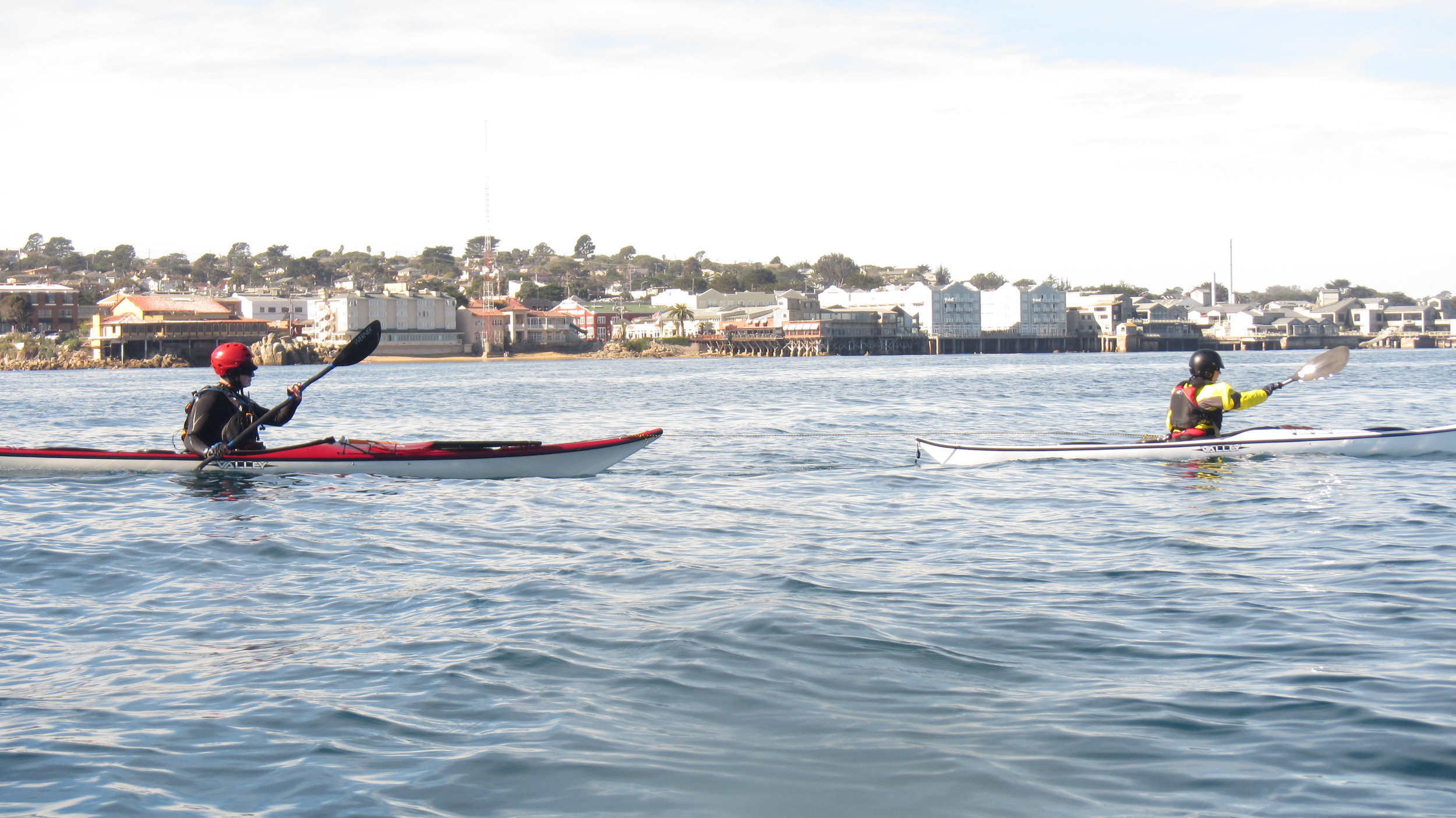 Sea kayak towing drill in Monterey Bay
