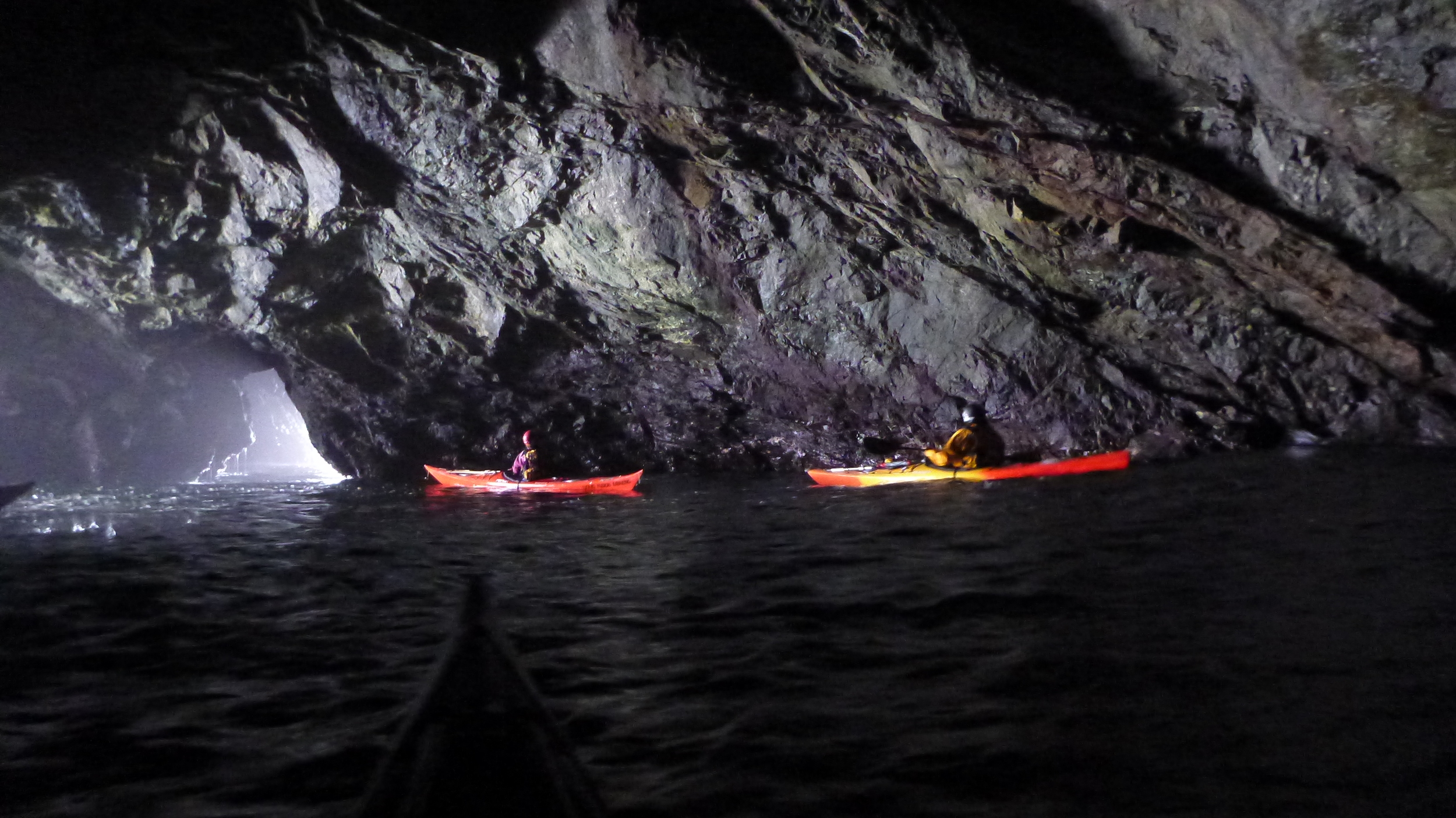 Sea kayaking through Mendocino sea caves.