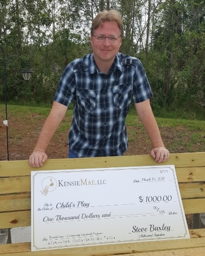 Product/Support Manager Steve Baxley with his donation to Child's Play