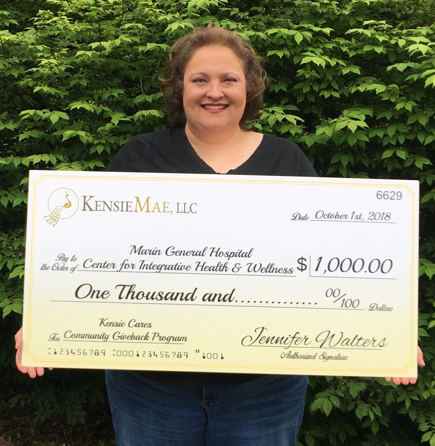 Kensie Cares recipient, Jennifer Walters, proudly presenting her donation to the CIHW at Marin General Hospital.
