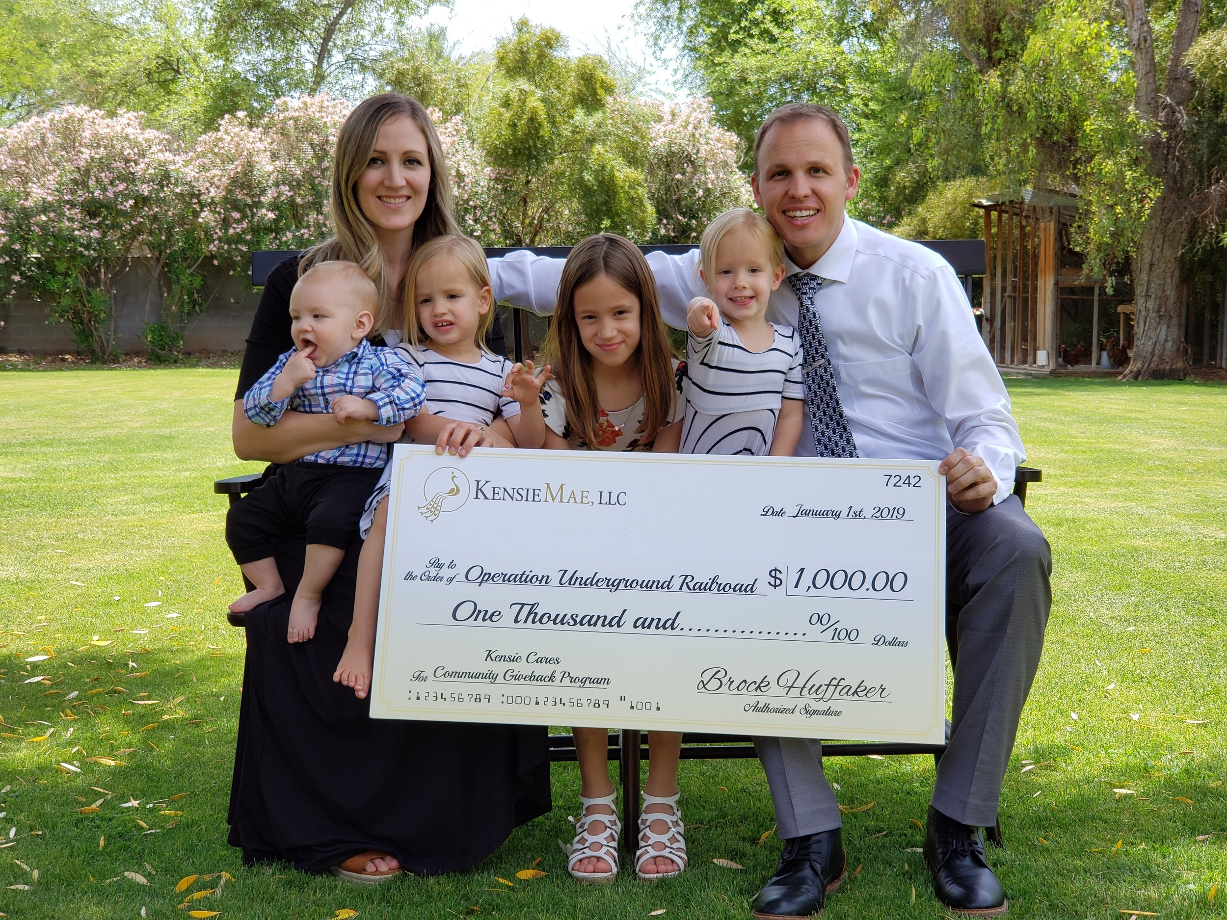 KensieMae/KensieMae Technologies CTO, Brock Huffaker, along with his family with their Kensie Cares donation to Operation Underground Railroad.