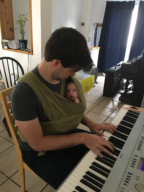 Peter playing for Esther when she was only a few weeks old