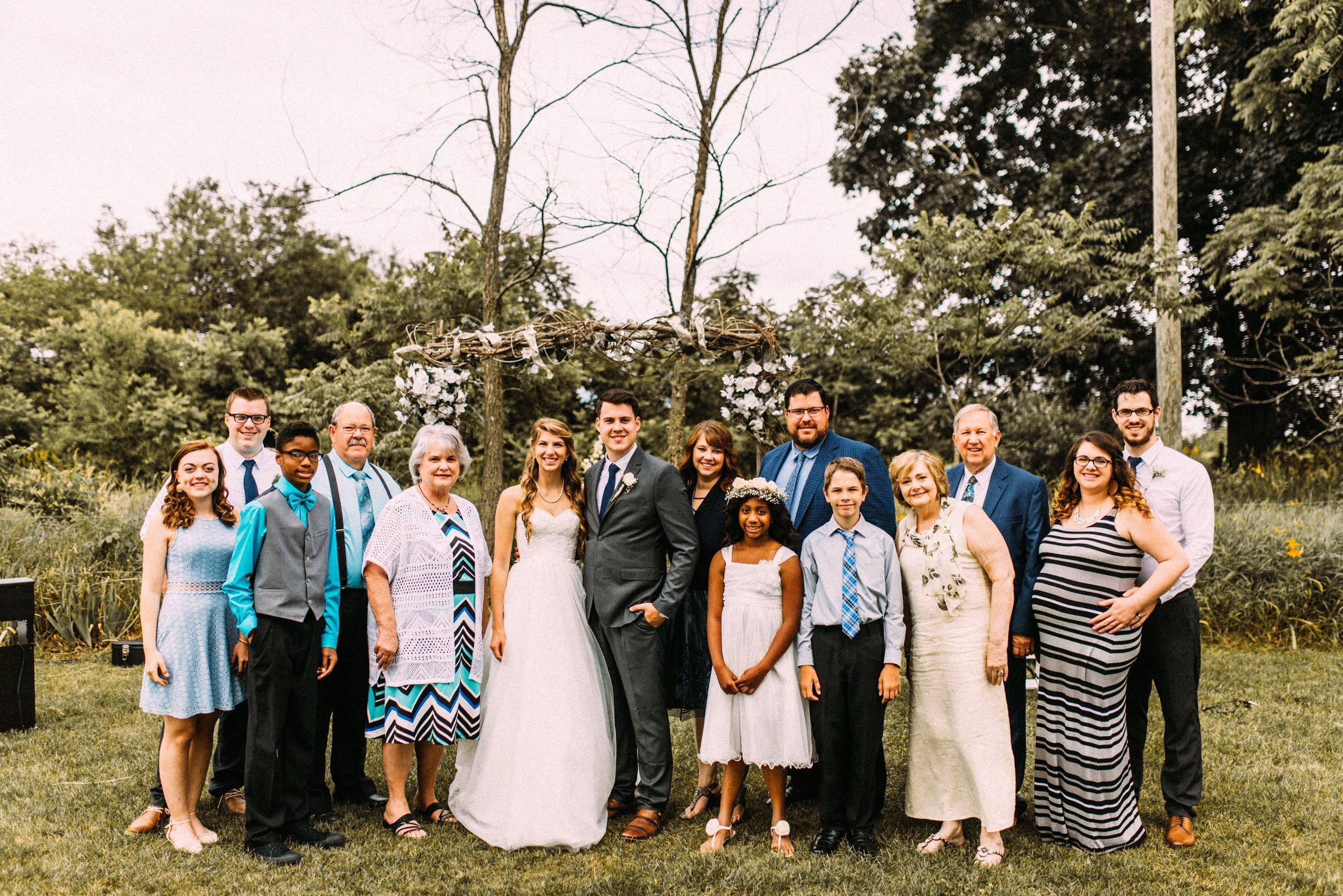 The family at Clayton & Olivia's wedding
