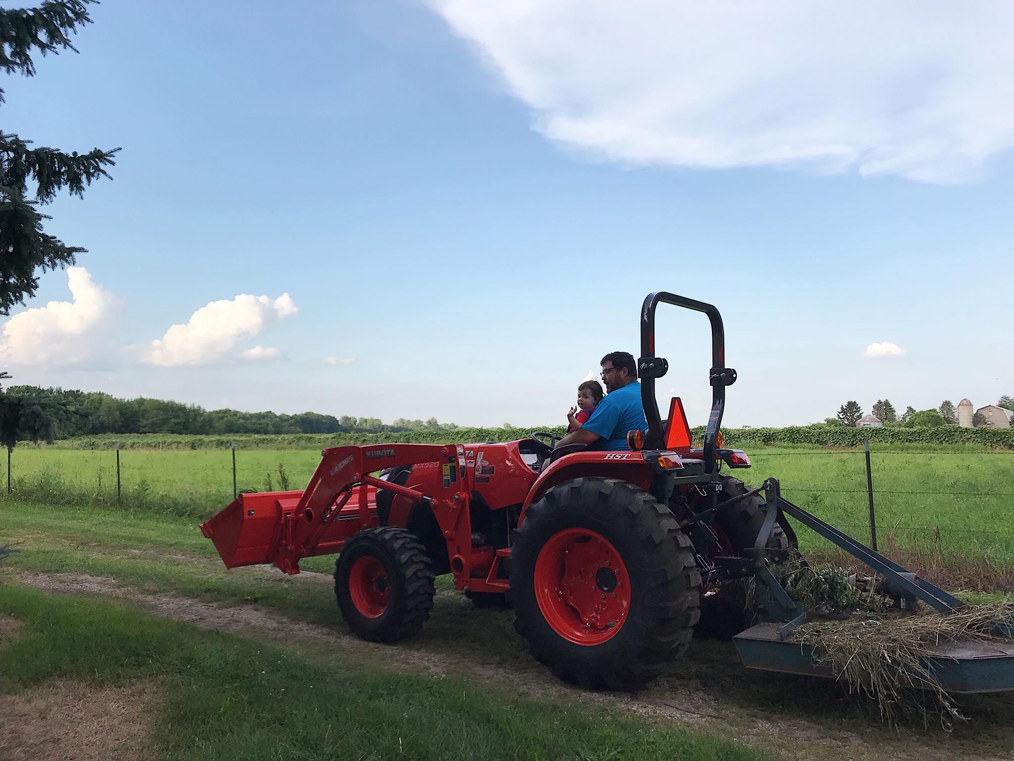 Taking a ride on Poppy Webb's new tractor, July 2018