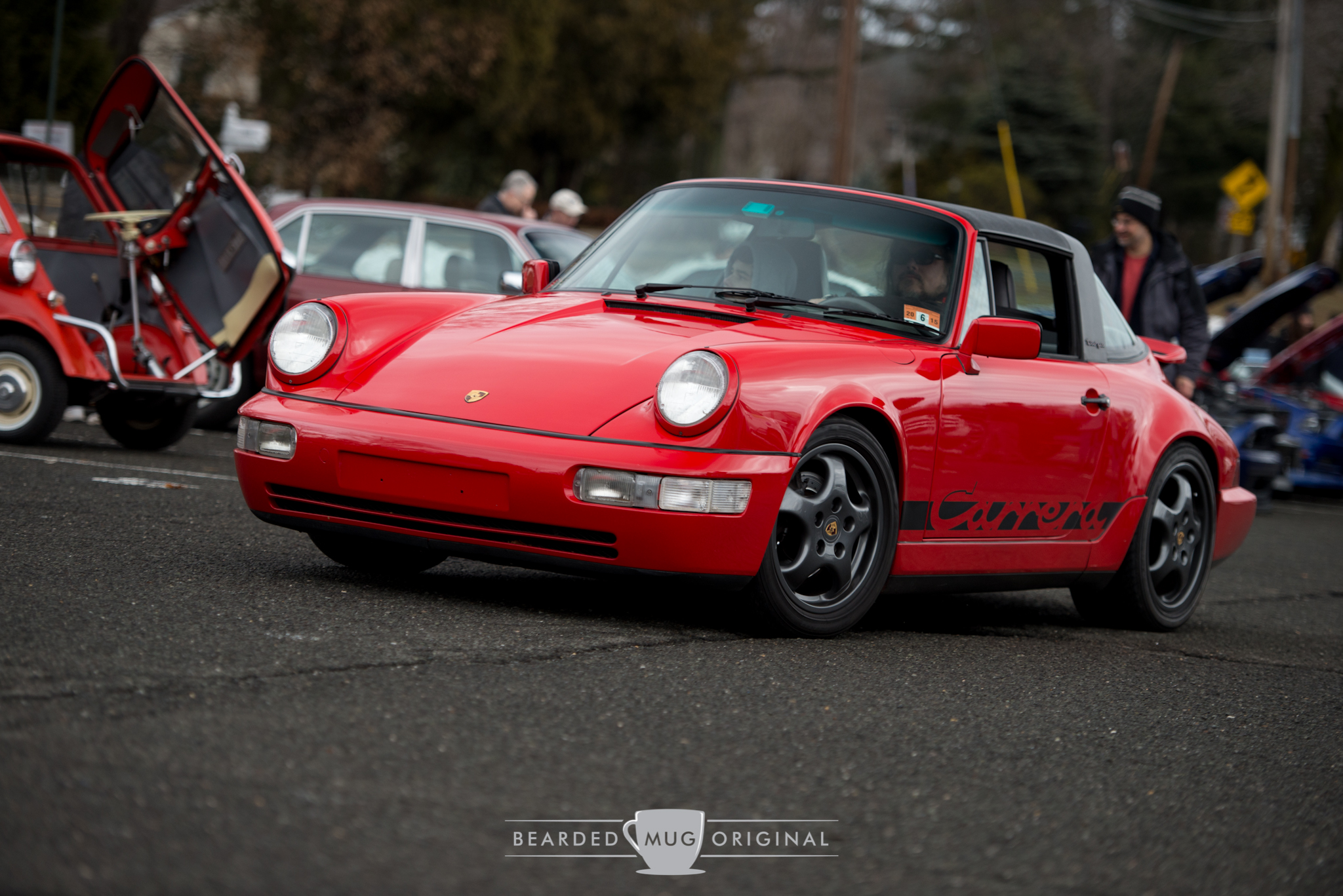 Jose and his minimally modified Guards Red 964 Carrera 2 Targa as seen leaving the lot.