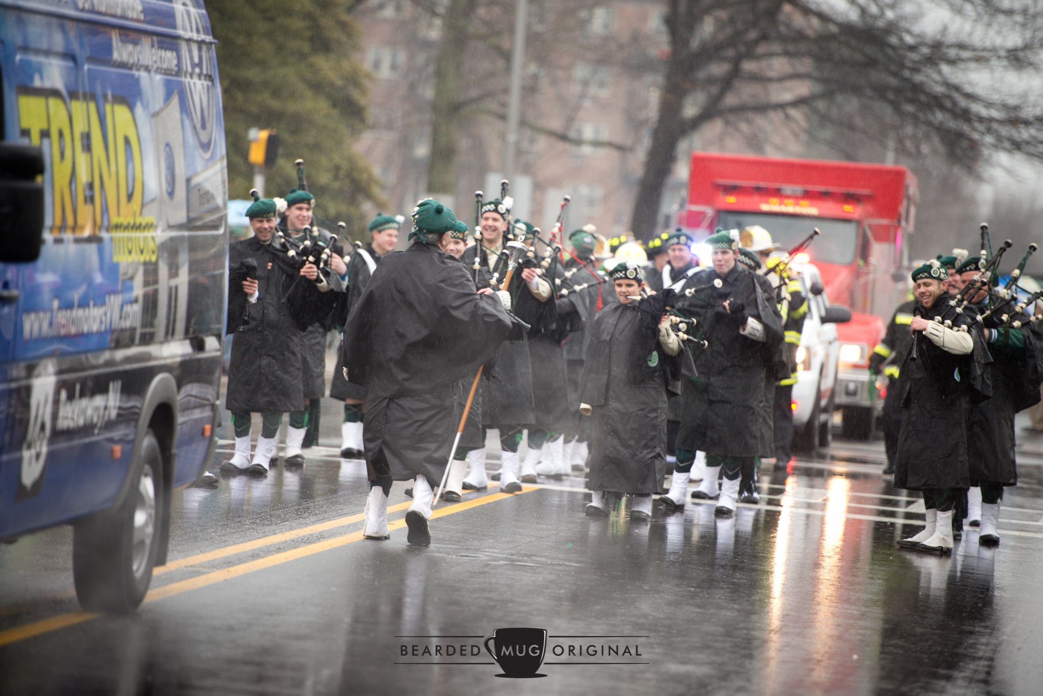 Waterproof your pipes: the bagpipers of the American Weldry Band won't let the soggy weather drown out their sound, or their smiles.