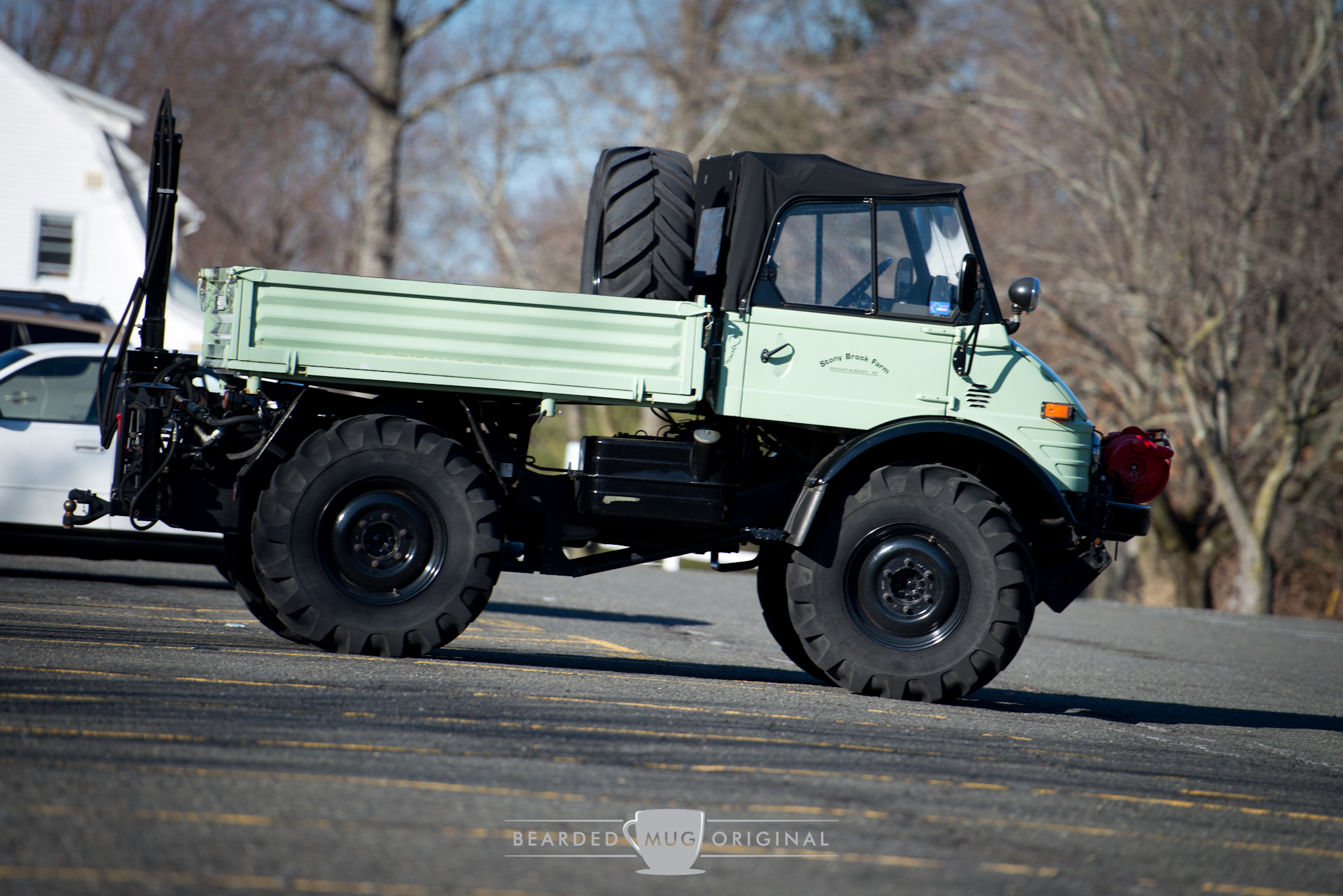 This Unimog, brought by Stony Brook Farm, is outfitted with everything that makes the Unimog badass;giant knobby tires with a spare, winch, canvas top, snorkel (not pictured), and some sort of hydraulic attachment on the rear.