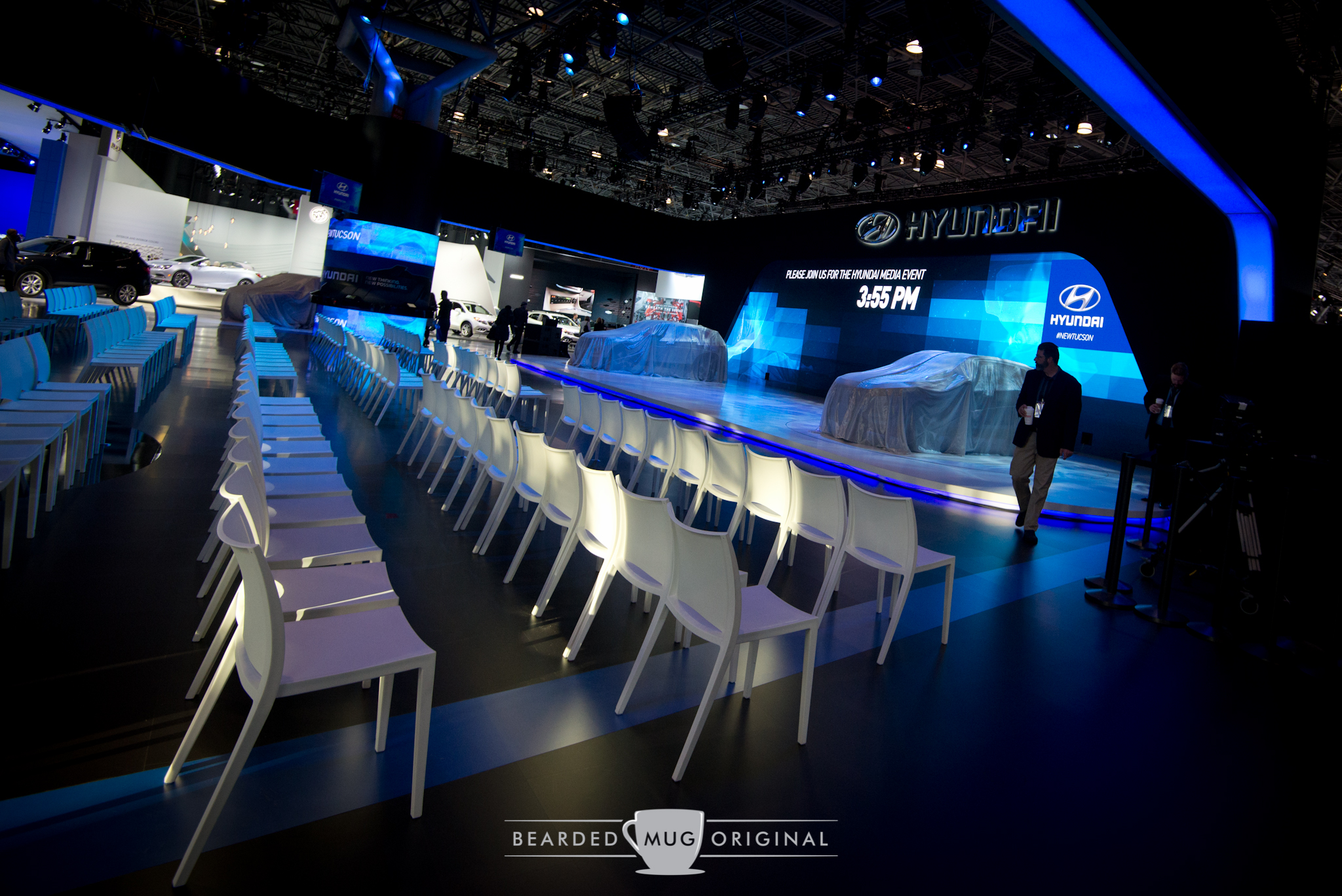 Hyundai's area remained vacant until the indicated time, with new SUVs covered by cloths on the stage.
