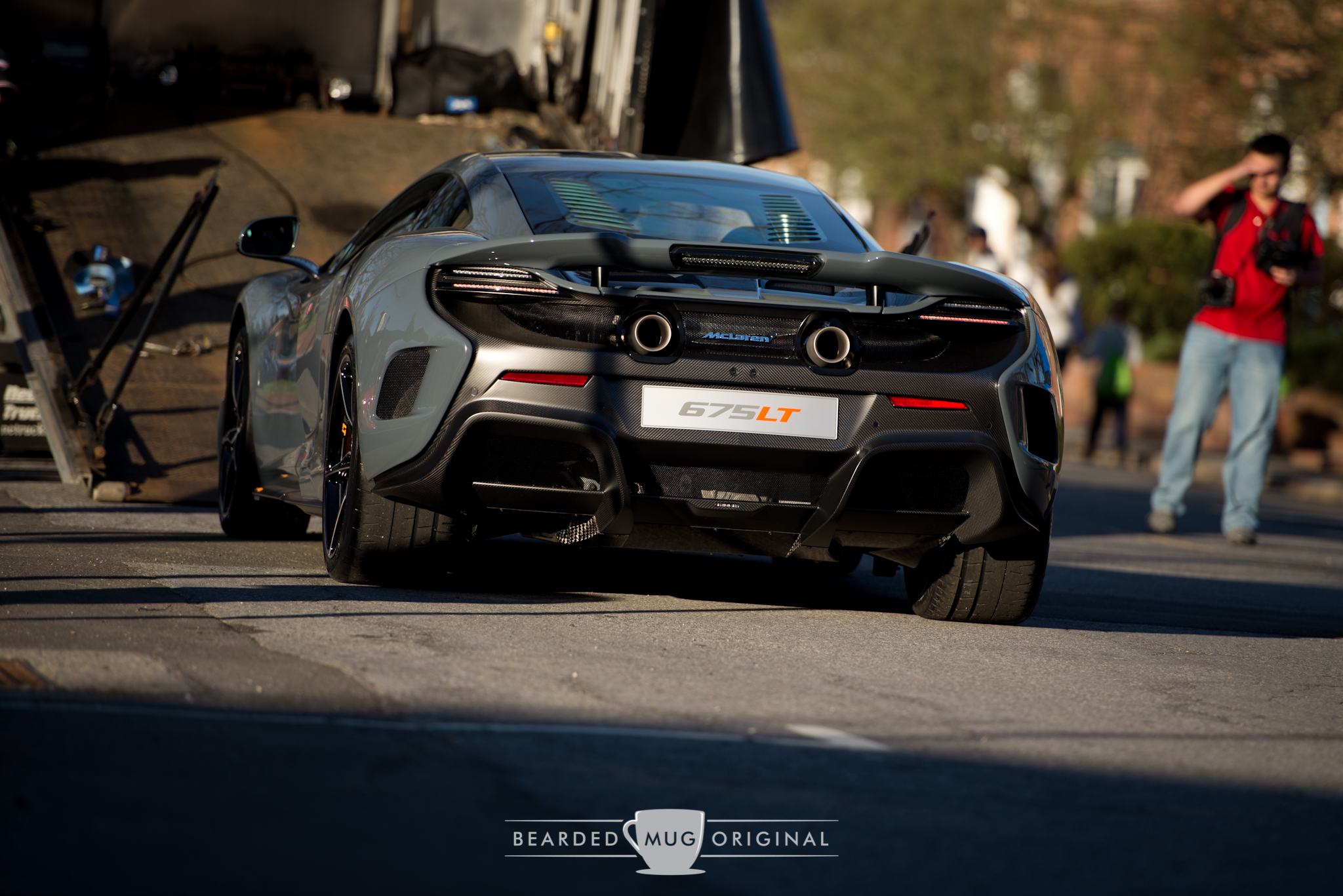 McLaren's limited-production 675 LT is being off-loaded to an awaiting crowd of one eager photographer.