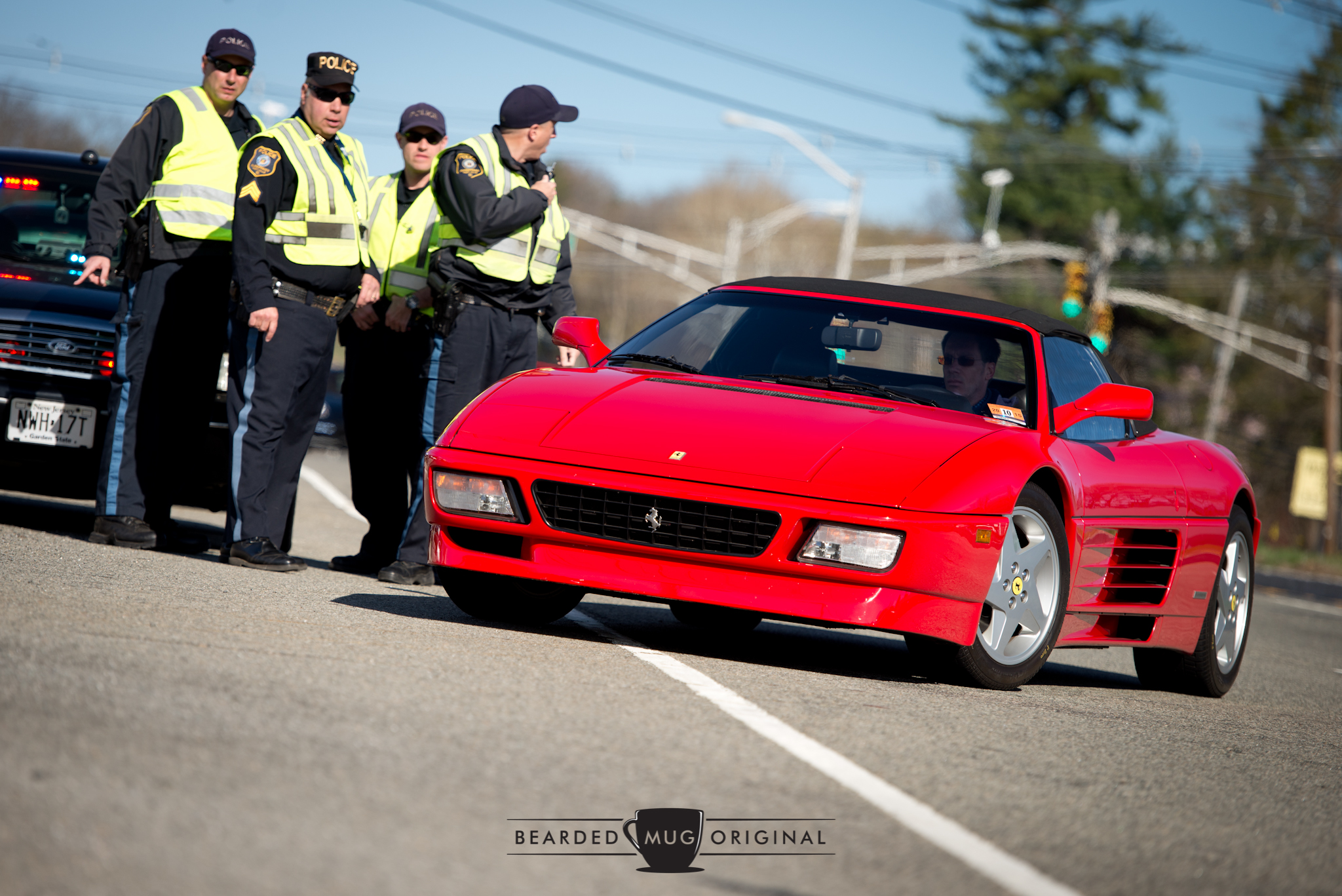 Ferrari 348 enjoys extra protection while making the right-hander ino the lot.