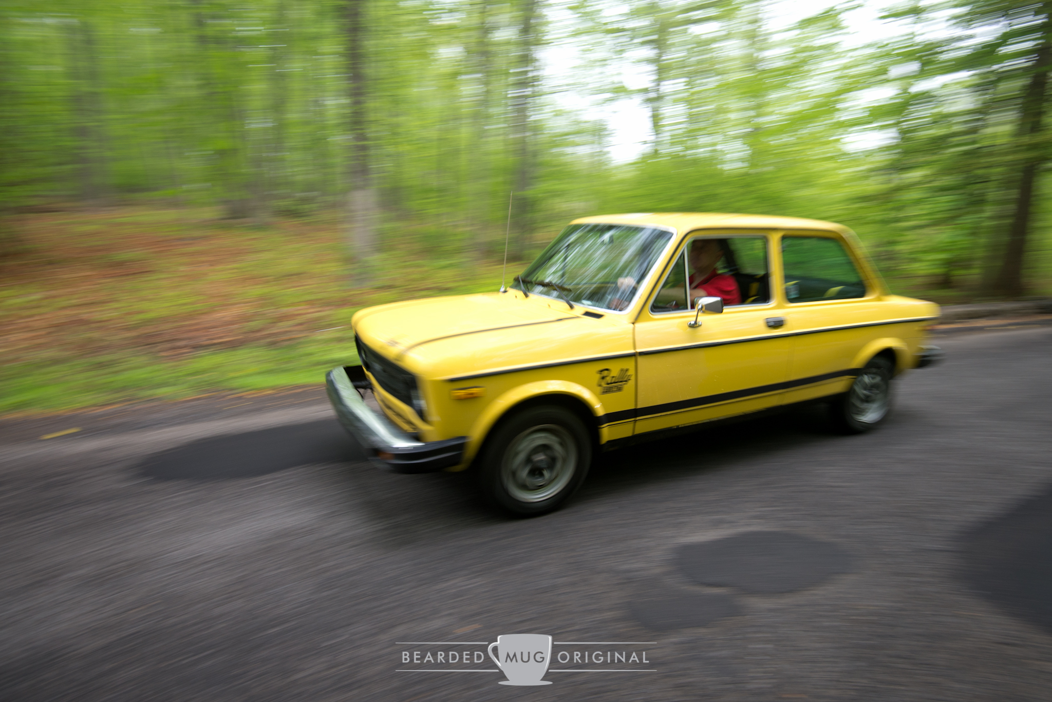 1977 Fiat 128 Rally Homologation built specifically for the US market buzzed right on by.