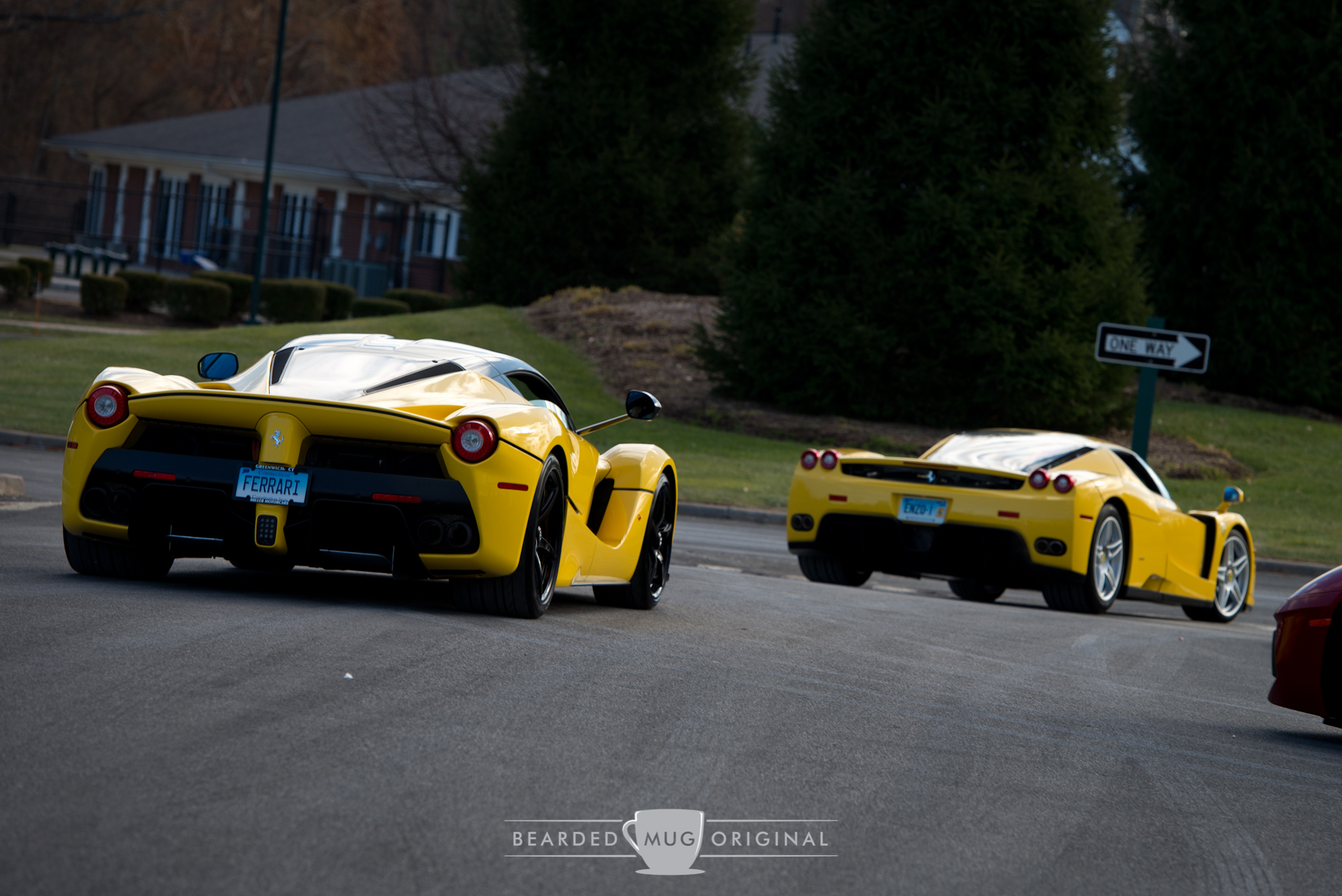 Talk about evolution. An Enzo leads the LaFerrari out of the lot after a successful morning of shooting the promotional picture for the event.