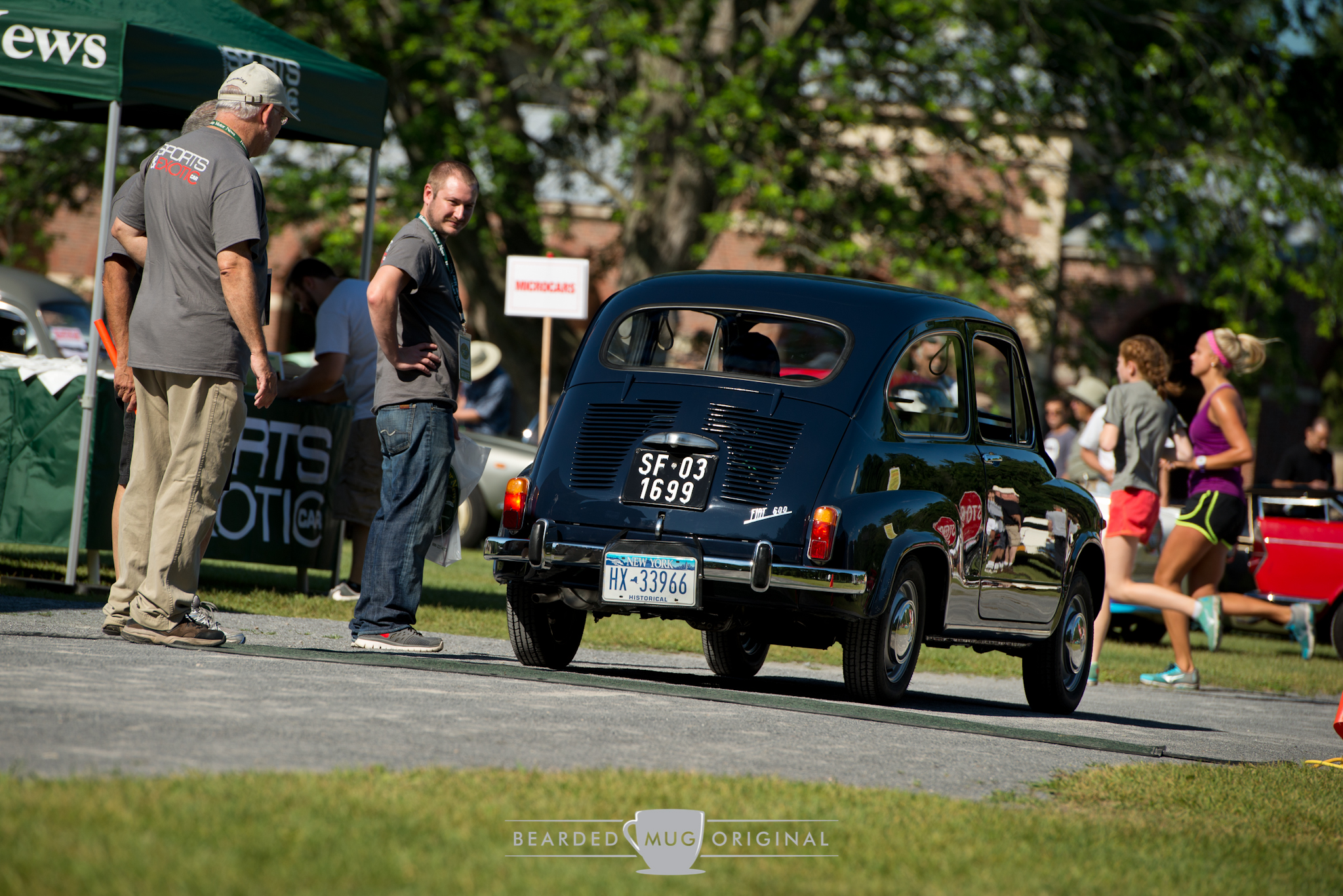 Fiat 600 was admired by the editors as unimpressed joggers trotted by.