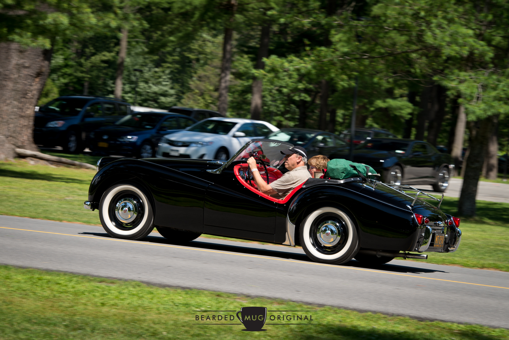 1957 Triumph TR3 owned by Gene and Glenda Tricozzi was another former Best of Show in attendance.