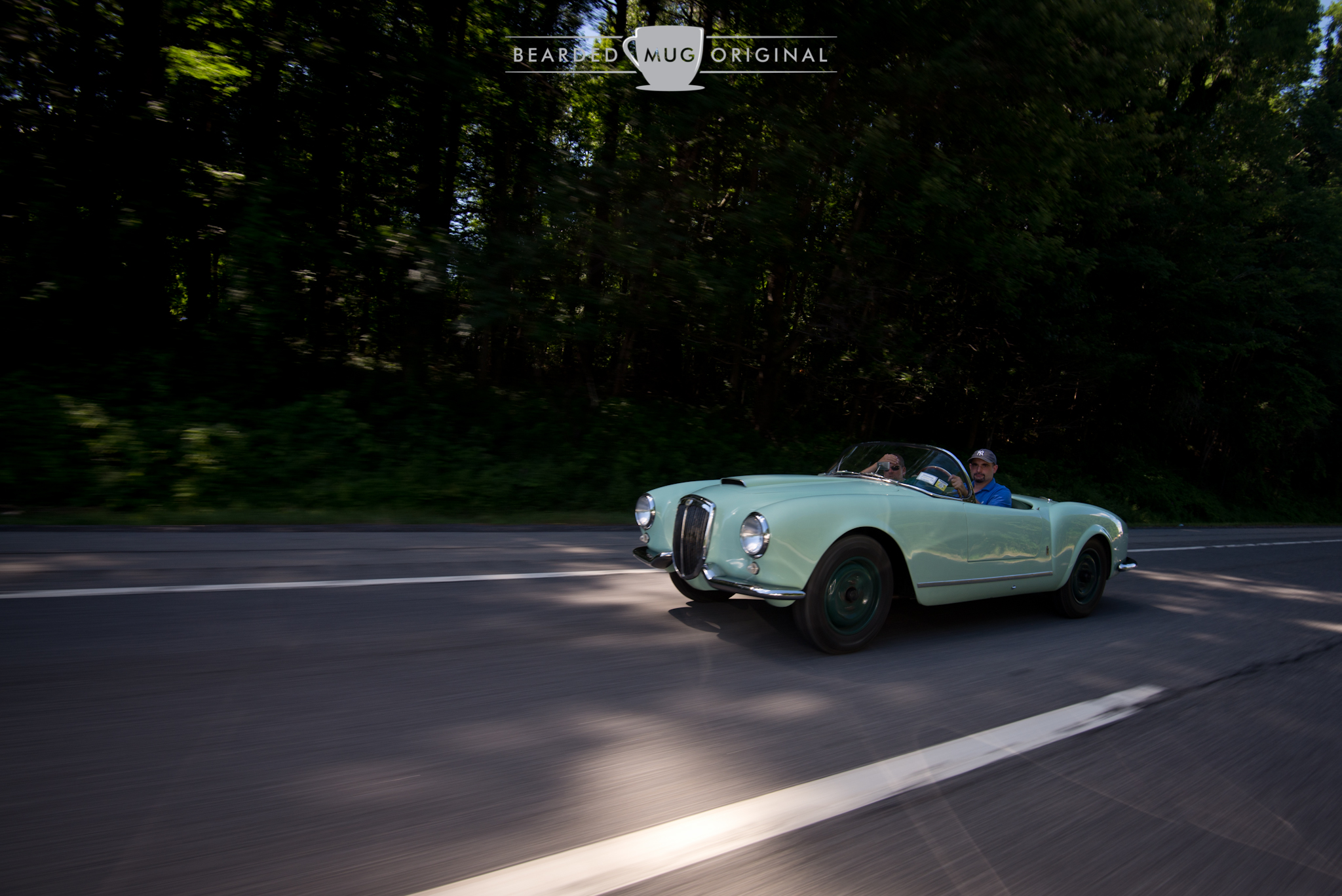 After chatting with the owner of this 1955 Lancia Aurelia Spider at a gas station, I slowed down on the highway to allow him to catch up to capture this shot.