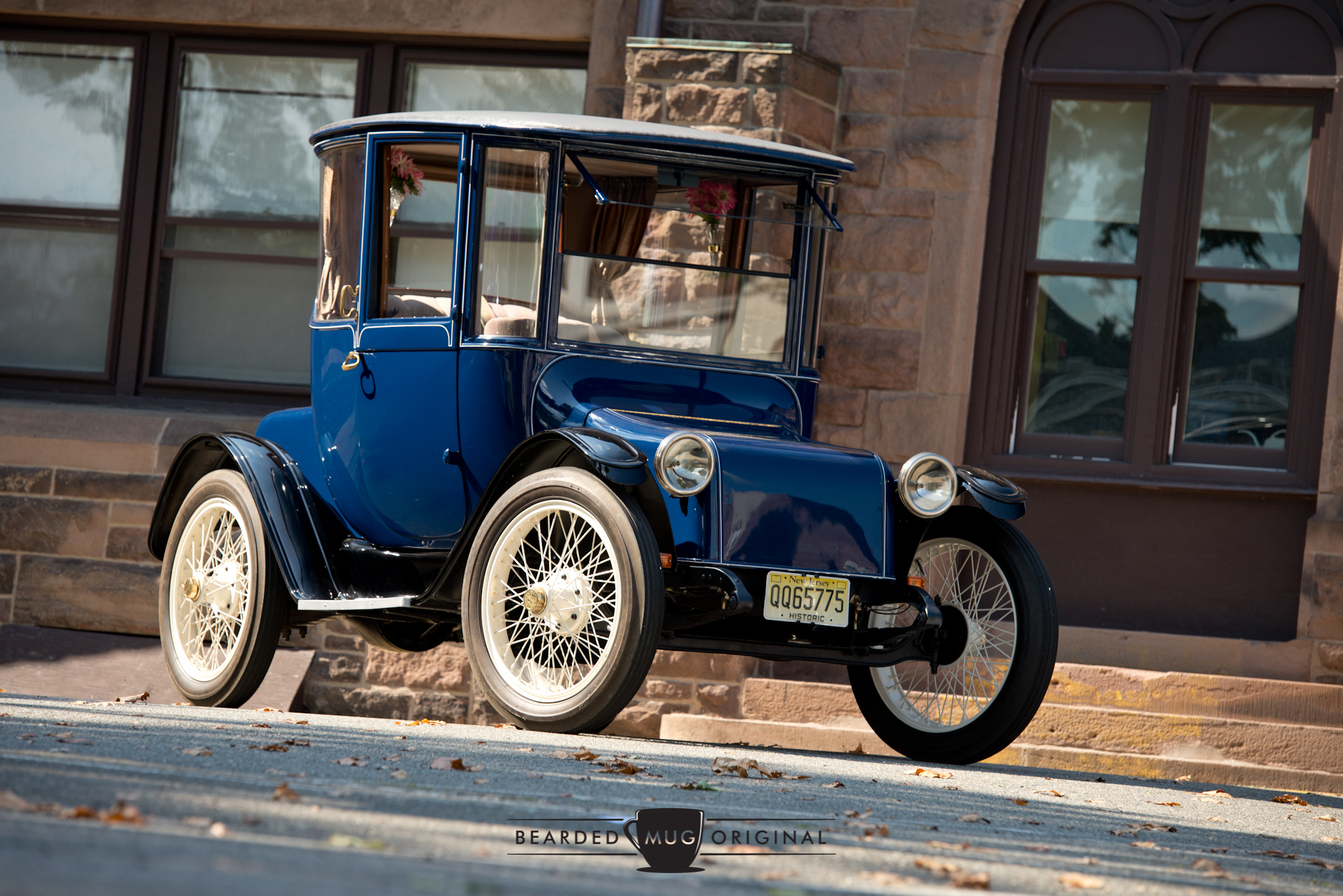 The size of the 1917 Detroit Electric Model 68 can't be fully appreciated until you're standing next to it. Its height accommodated for hats, so the roof was much taller than today's cars.