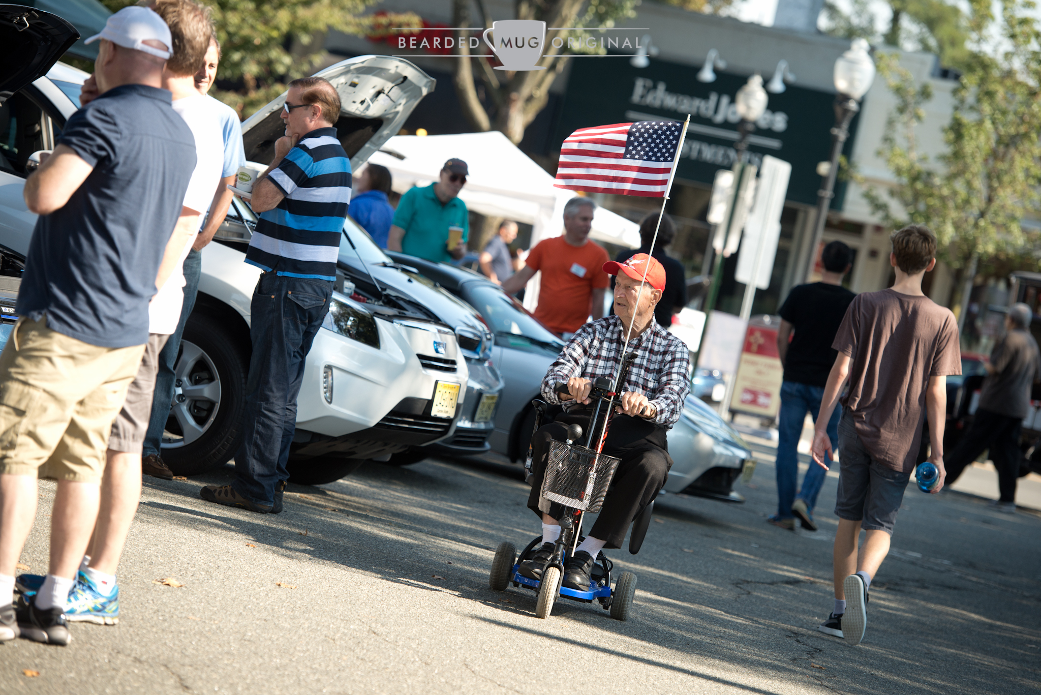 A unintentional tip of the hat:electric cars being enjoyed from an electric scooter.