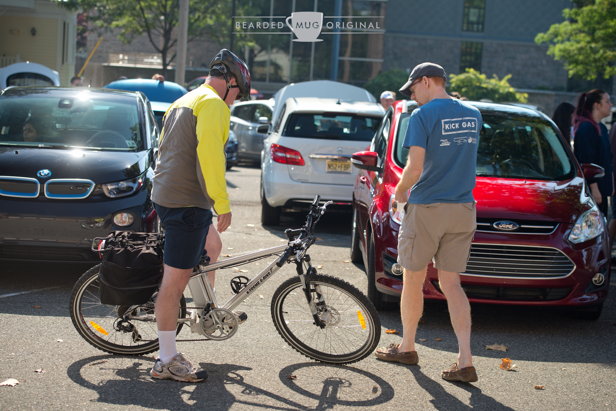 Alex Brown chats with a passing cyclist, who happened to be riding an electric bicycle.