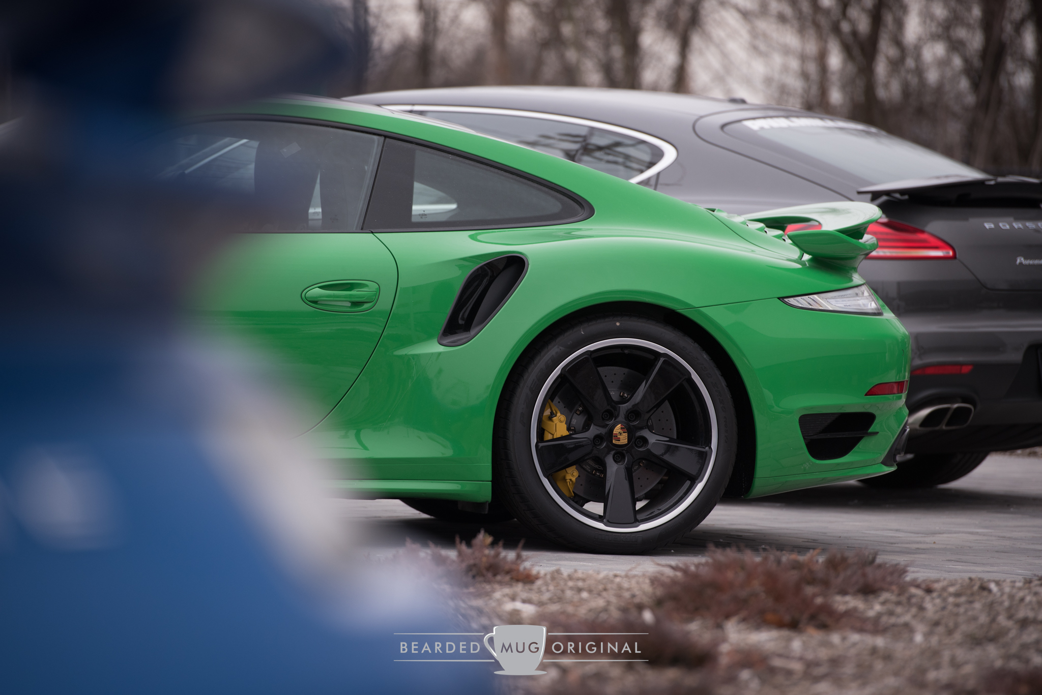 The juxtaposition of the blue and green Turbos was a great way to battle the blandness of the winter. Don't mind the gray Panamera in the background; no one handed me keys to shuffle the inventory.