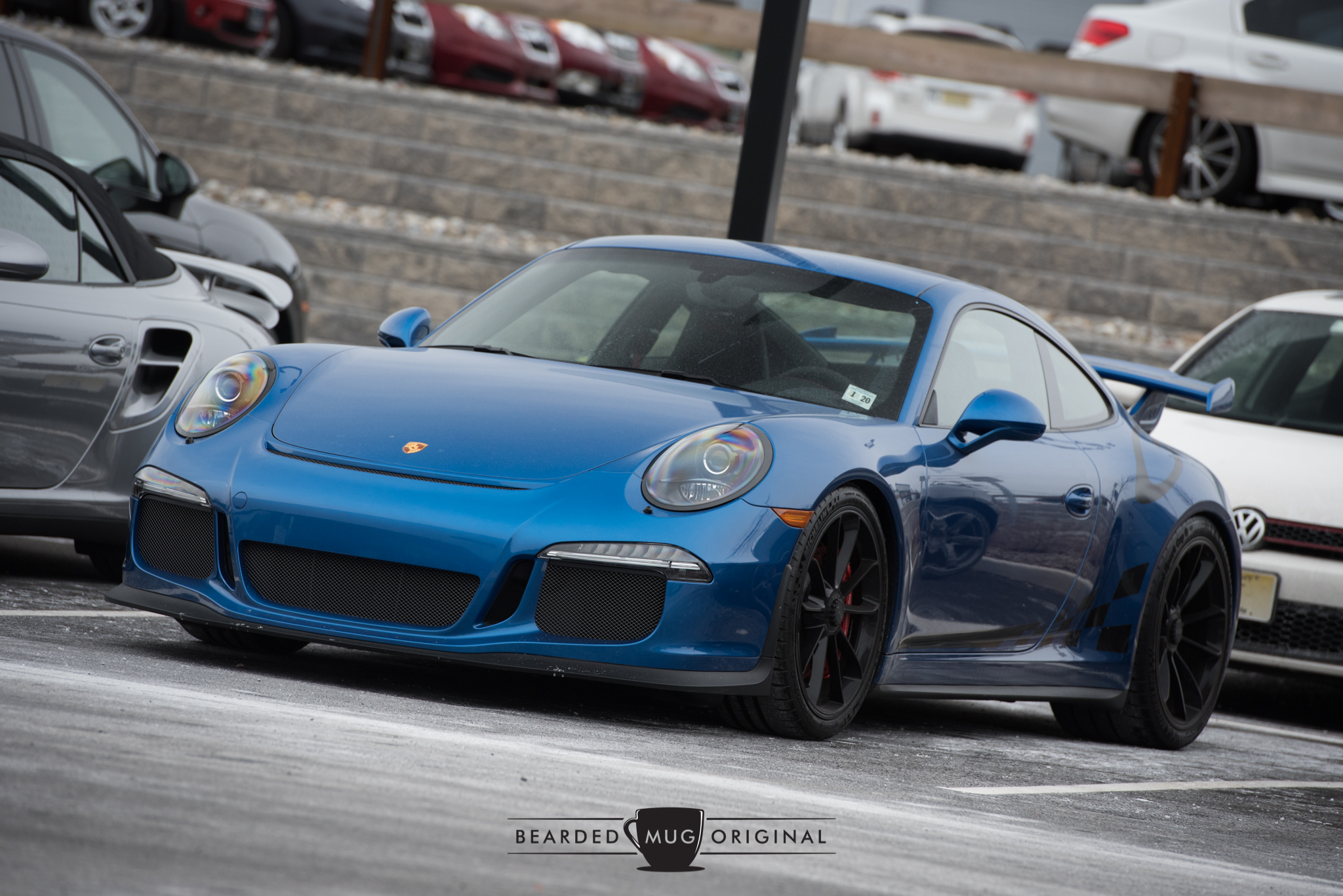 Why not finish out with a 991 GT3 in a stunning Sapphire Blue Metallic?