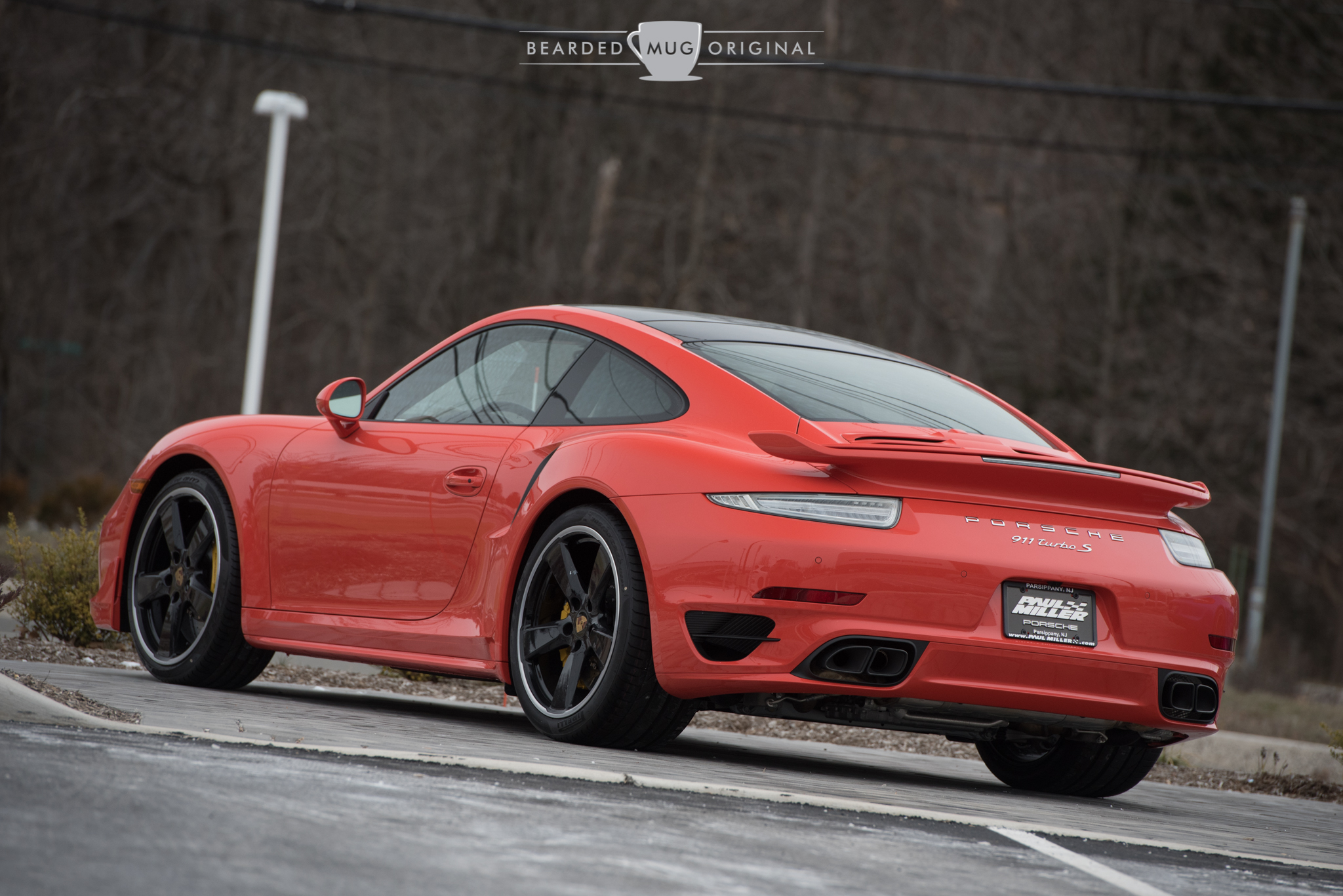 This Lava Orange 991 Turbo is outfitted with a grocery list of extras, including (but not limited to) gloss black wheels and sport mirrors, the aero kit and the glass sunroof. Finding an scantly optioned Porsche is like finding that proverbial needle.