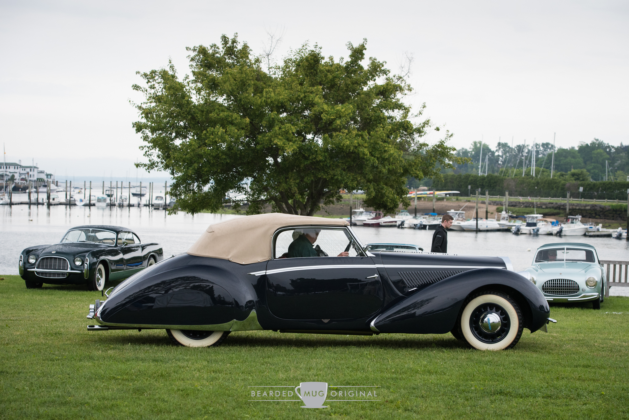 Look ma, no tent! A 1939 Delage D6 Convertible passes its stablemates before finding its place amongst the Best of the Best.