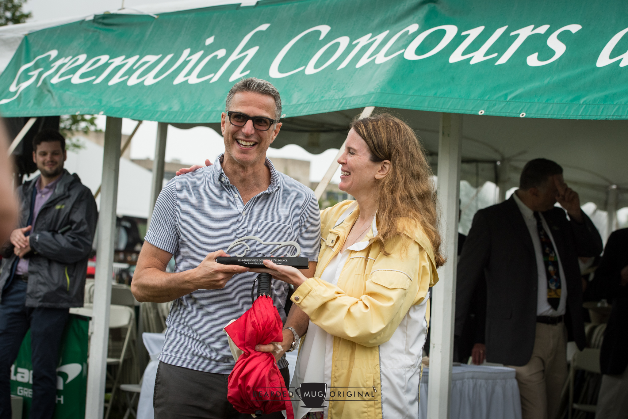 Mary Wennerstrom shares a laugh with double-fisting winner Phil Toledano, who brought home the Journalists' Award for his 1980 Porsche 924 Carerra GTS Clubsport Coupe and the Homologation Special honor for his 1982 Lancia 037.