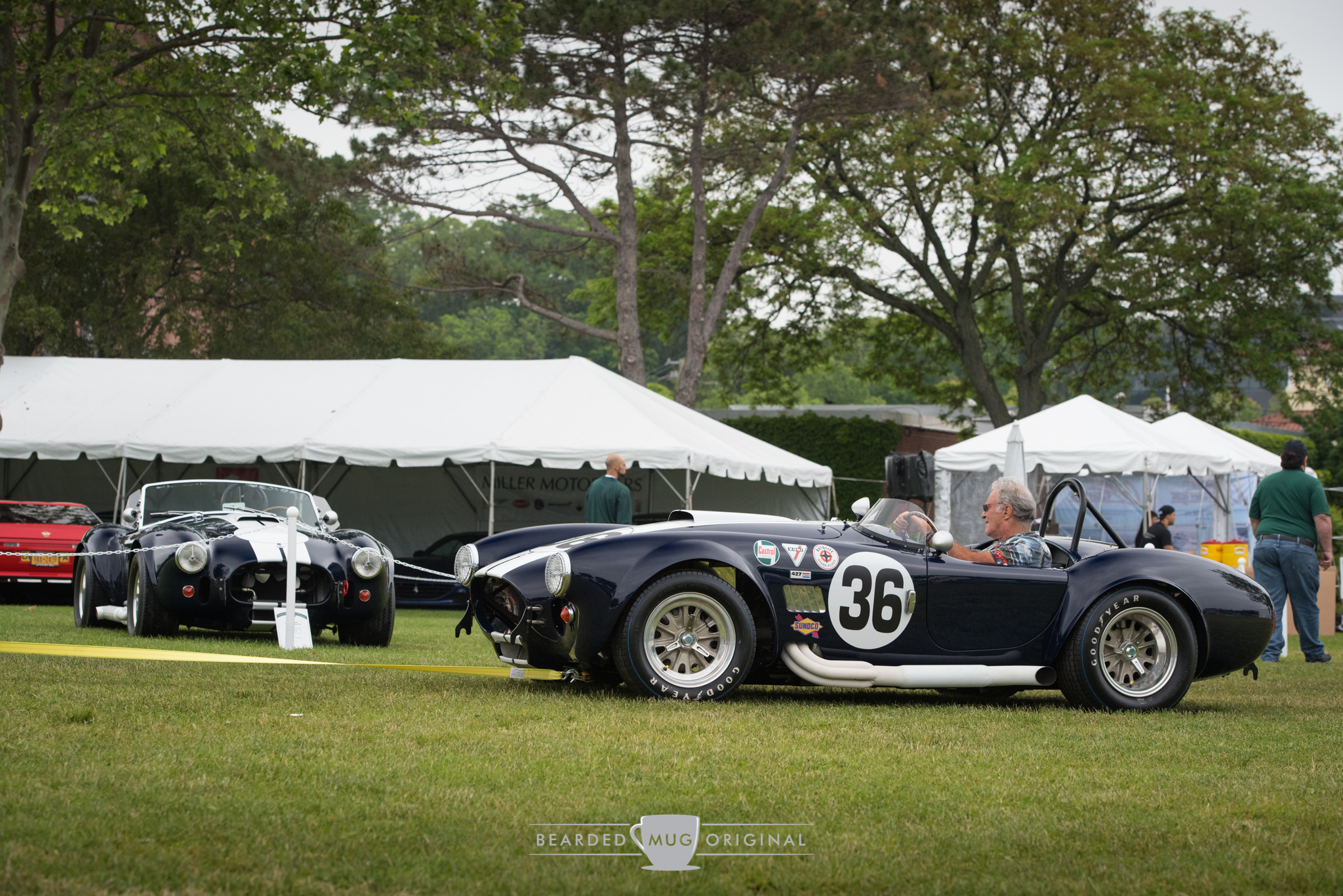 I can only imagine the immense feeling of joy one must have when they're being pulled past their parked tribute Cobra while behind the wheel of their authentic Cobra. #GOALS.