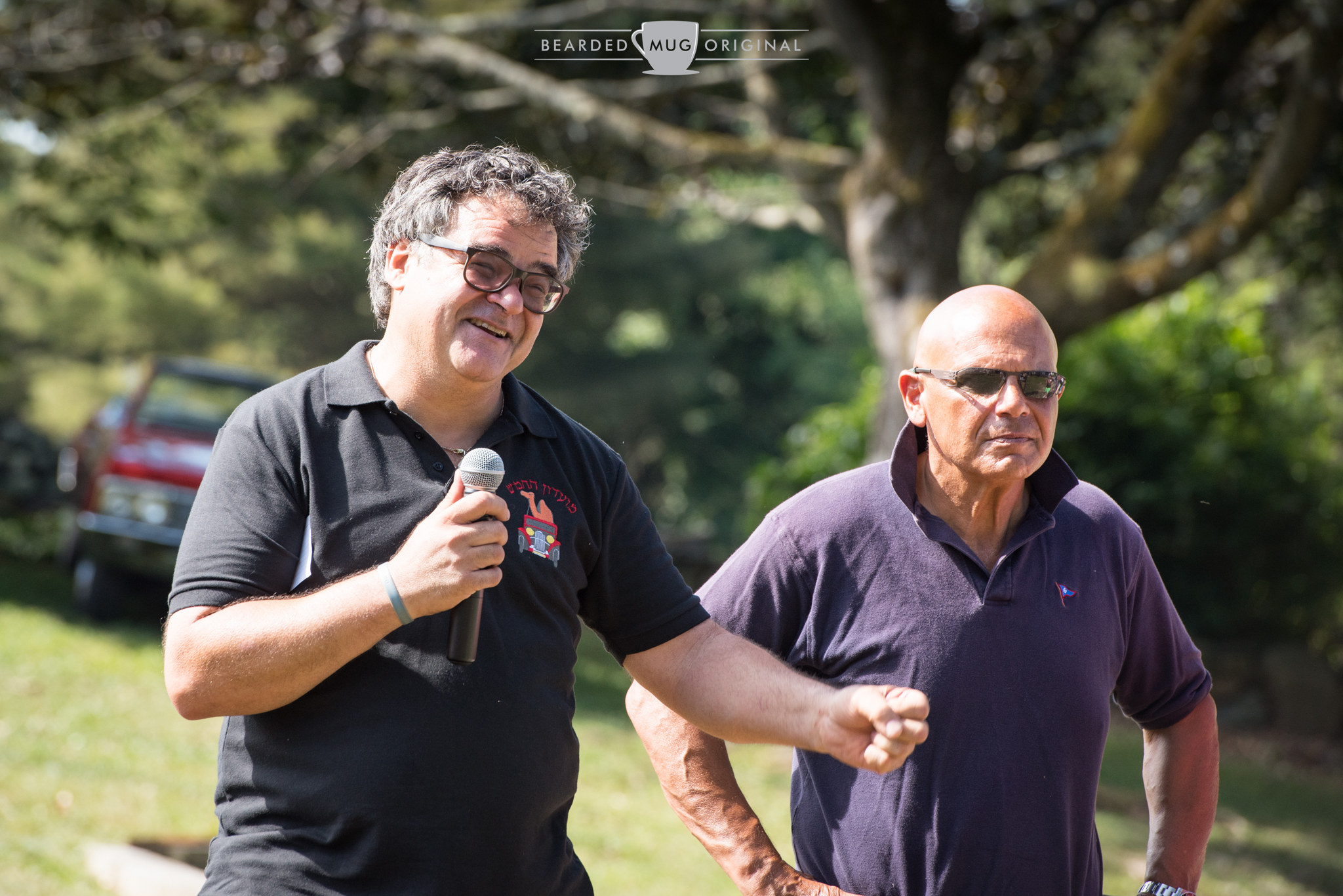 Santo Spadaro, son of Domenico and possessor of one of the friendliest faces, addresses the crowd of over 350 before the cars set off on their journey. Next to him is Mike Bruno, who has played an invaluable role in the Memorial Drive over the years.