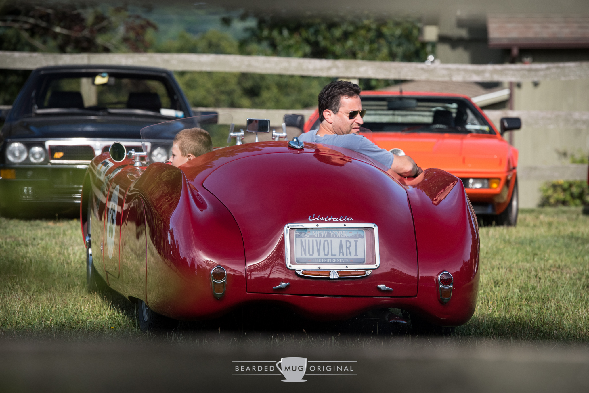 """A 1947 Cisitalia 202 SMM """"Nuvolari Spider"""" is a legend amongst legends, as indicated by the BMW M1 and Lancia Delta Integrale Evoluzione parked across the field."""