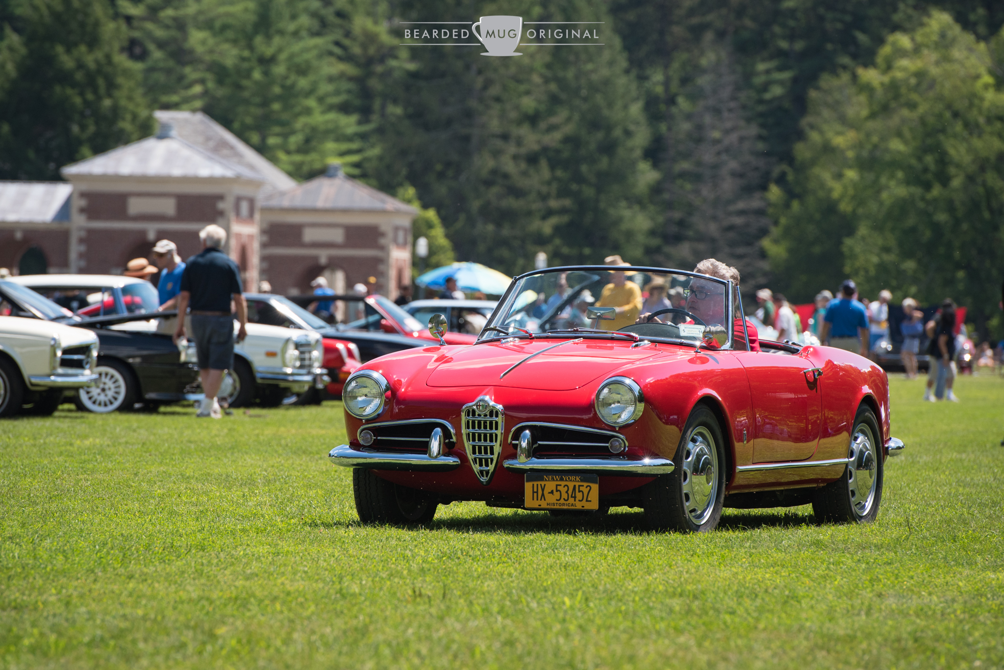 The Alfa Romeo Giulietta Spider combines top-down motoring with that unmistakable sound of a vintage Italian engine.