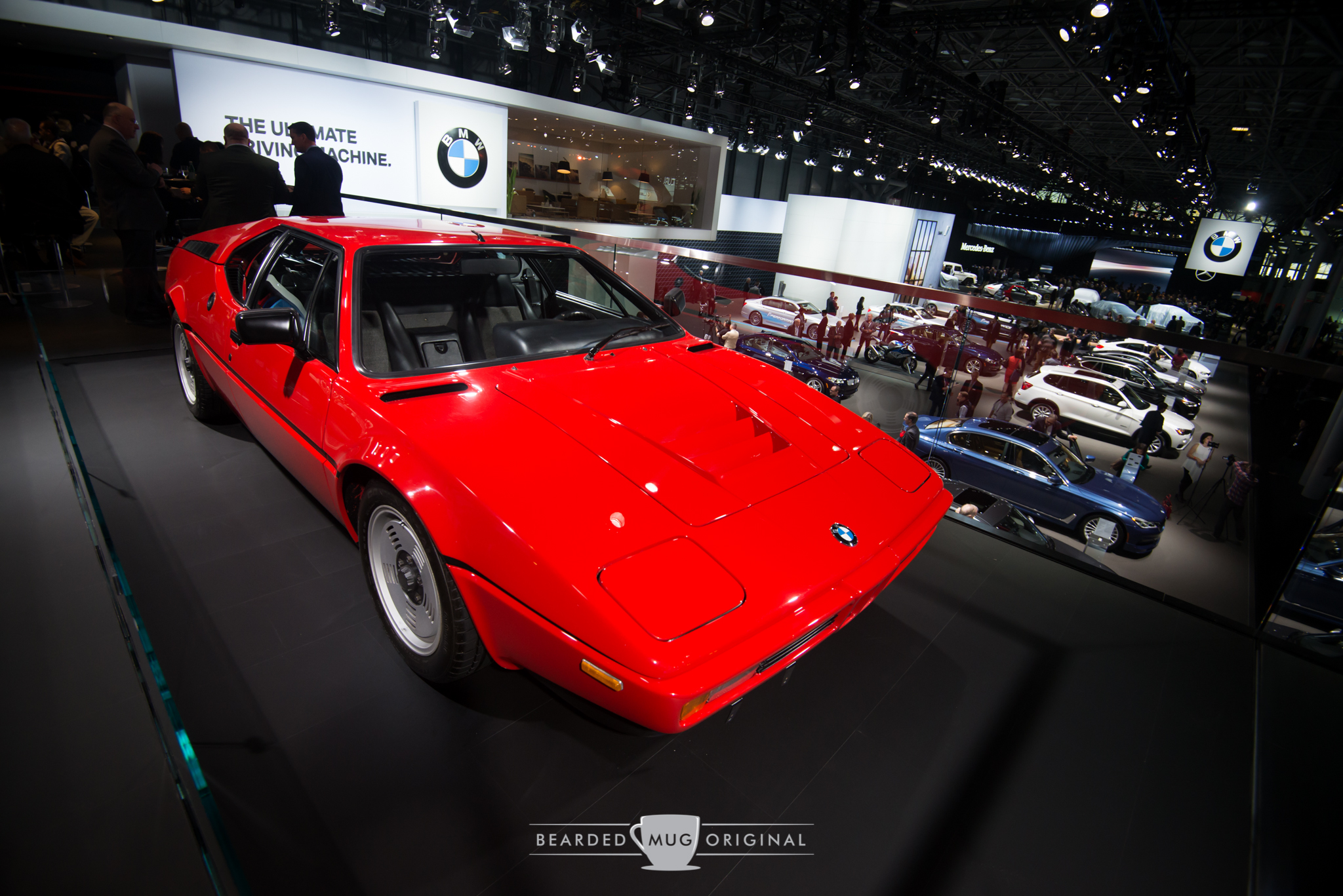 Iconic BMW M1 is on display high above the marque's floorspace.